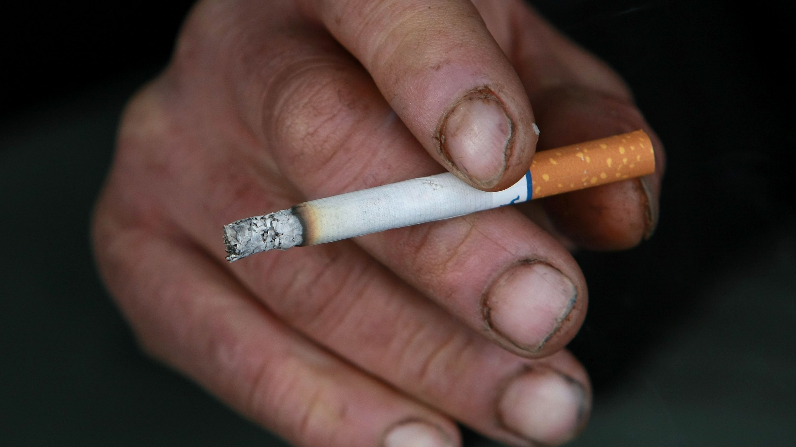 A man holds a cigarette outside of a tobacco store December 15, 2008 in San Francisco, California. The U.S. Supreme Court ruled today that people may file lawsuits against tobacco companies for deceptive advertising of 'light' cigarettes. (Credit: Justin Sullivan/Getty Images)