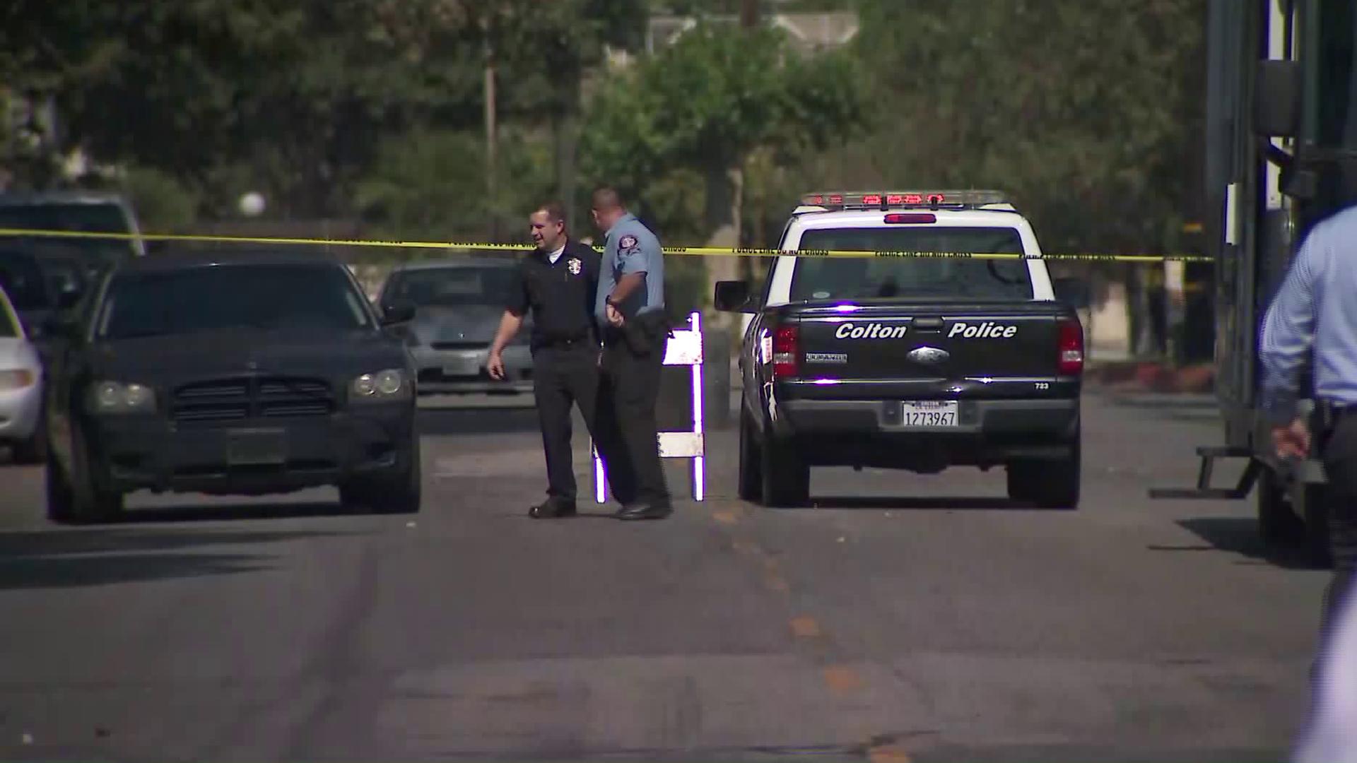 Police investigate a homicide in Colton on Oct. 23, 2018. (Credit: KTLA)