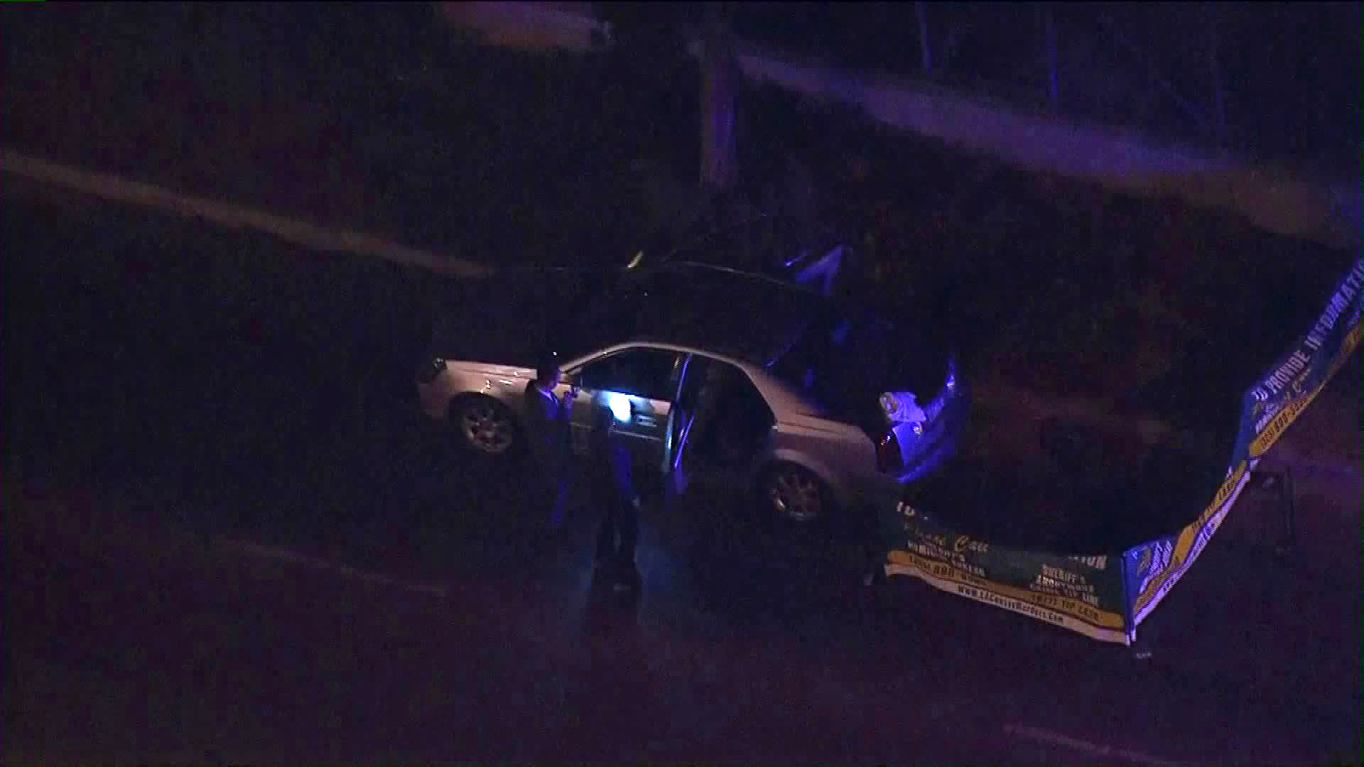 Authorities investigate the death of a man found shot in his car in Compton on Oct. 5, 2018. (Credit: KTLA)