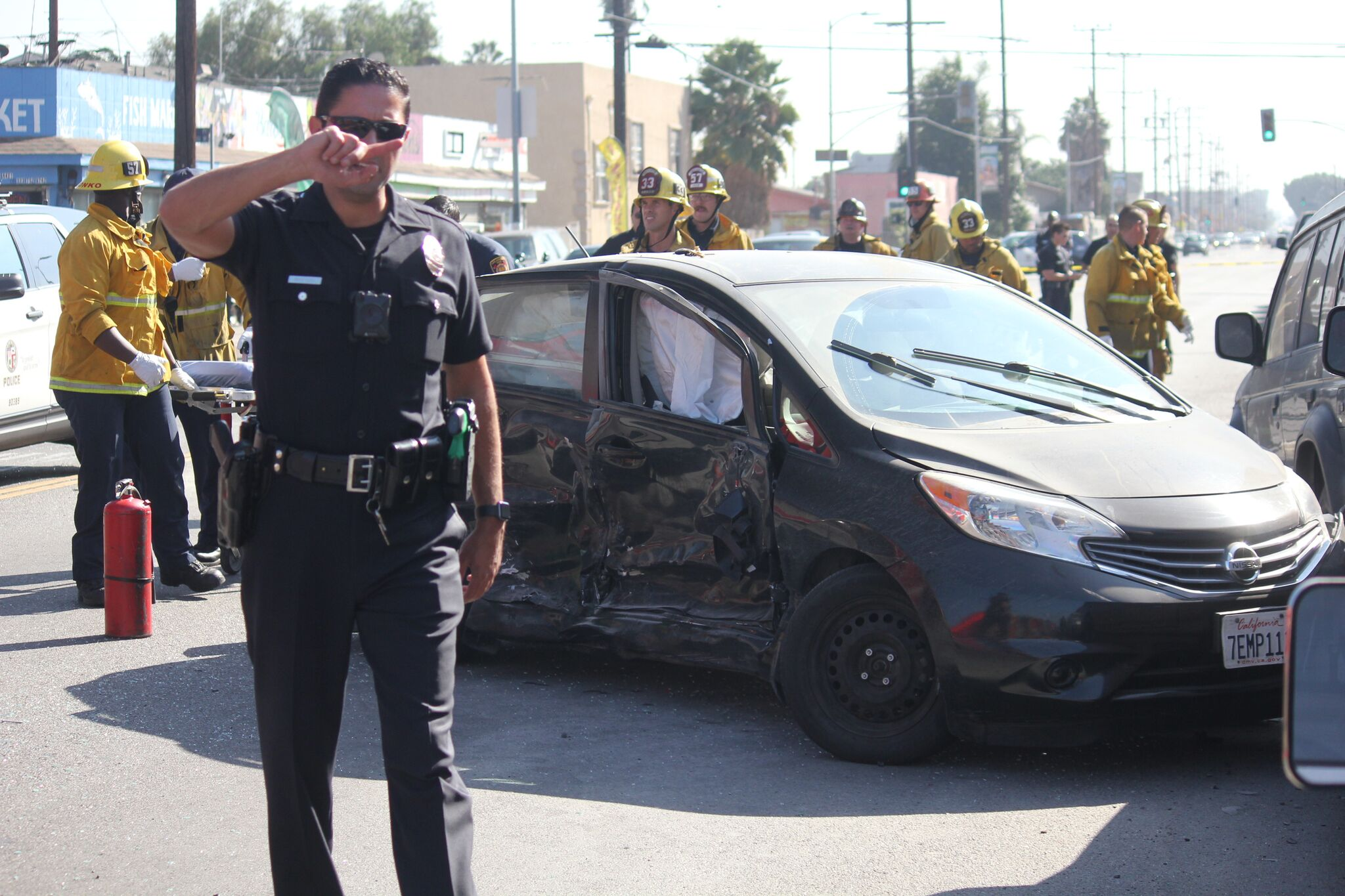 LAPD and LAFD respond to a crash in Vermont-Slauson on Oct. 23, 2018. (Credit: Pinkey Gray)