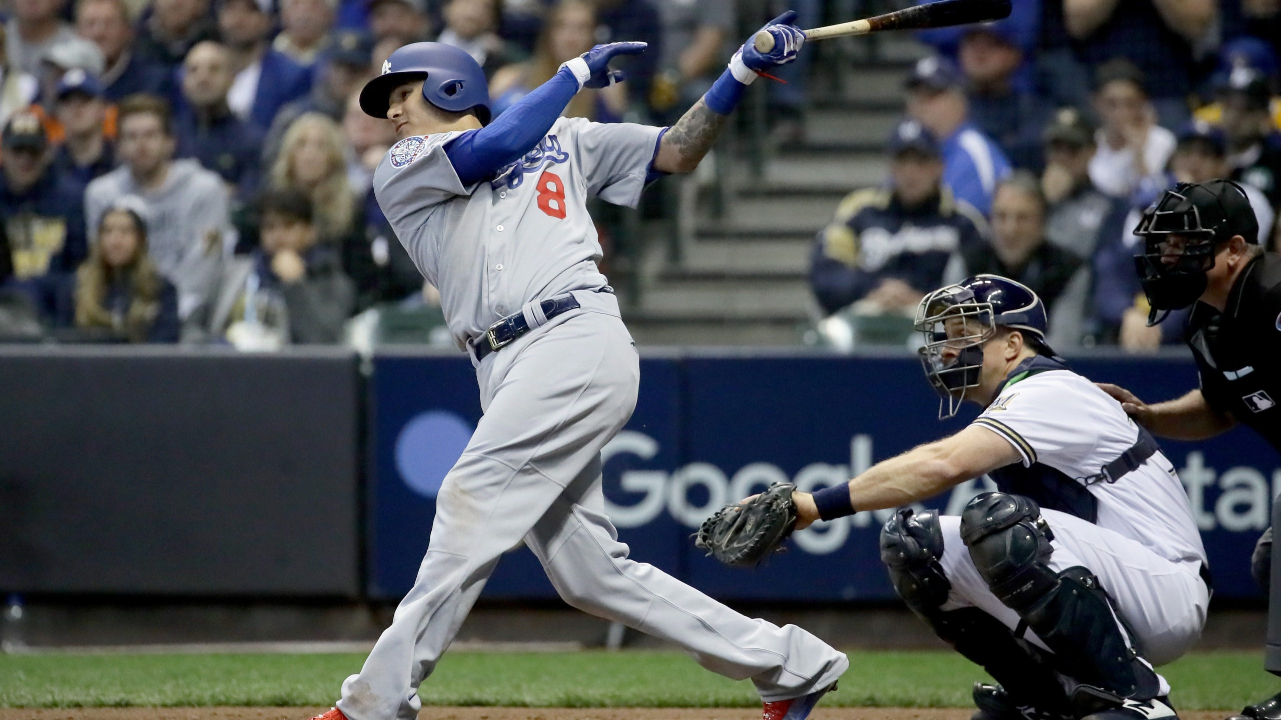 Manny Machado #8 of the Los Angeles Dodgers hits a single against the Milwaukee Brewers during the fourth inning Game Seven of the National League Championship Series at Miller Park on October 20, 2018 in Milwaukee, Wisconsin. (Credit: Jonathan Daniel/Getty Images)