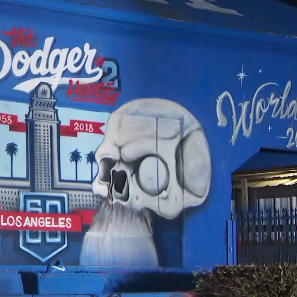 A home in Mid-City painted blue to honor the Dodgers during the 2018 World Series is seen in this image on Oct. 25, 2018. (Credit: KTLA)