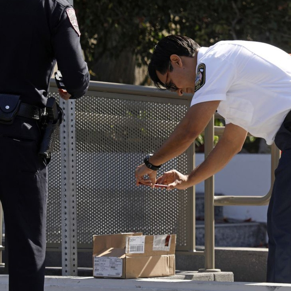 Police and fire officials investigate suspicious envelopes at the Los Angeles Times building on East Imperial Highway in El Segundo on Oct. 24, 2018. (Carolyn Cole / Los Angeles Times)