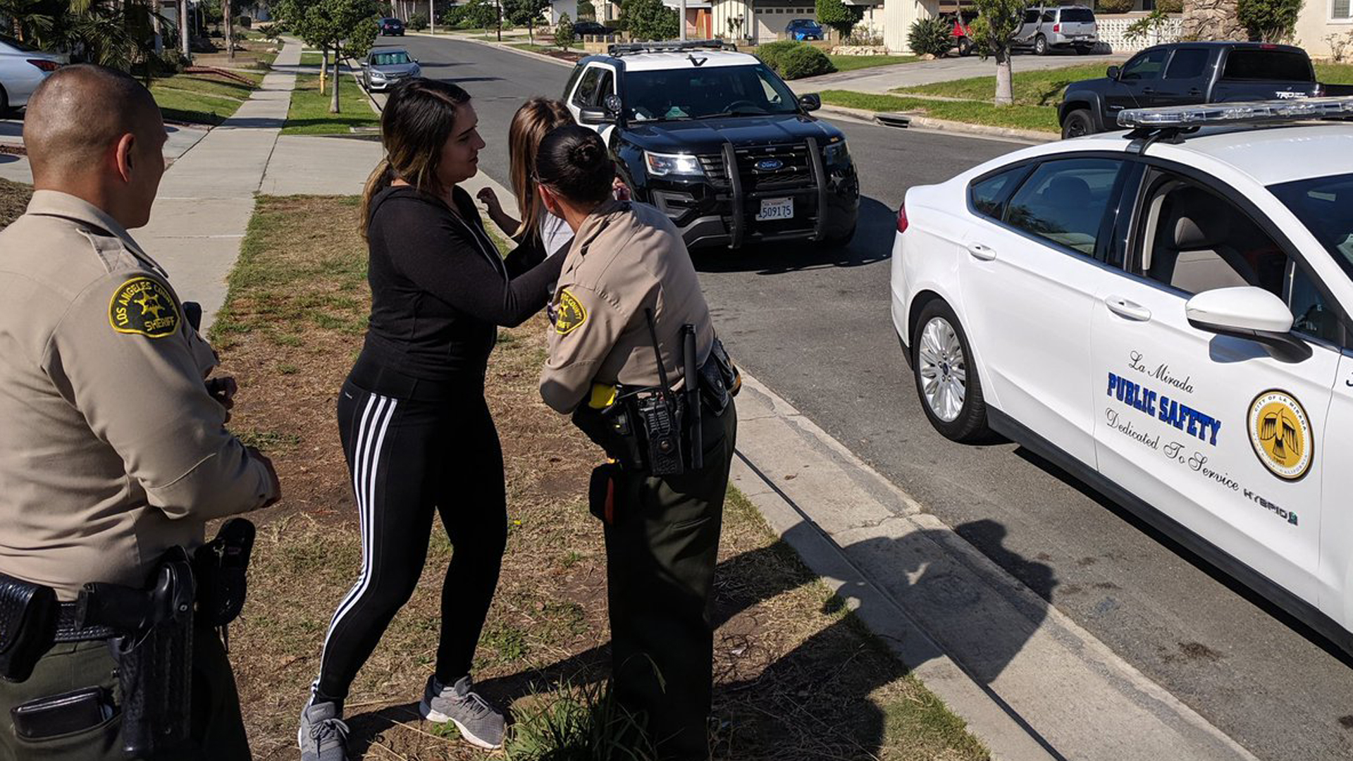 A good Samaritan and deputies helped reunited a young girl and her family after the girl was found wandering alone in La Mirada on Oct. 26, 2018. (Credit: Los Angeles County Sheriff's Department)