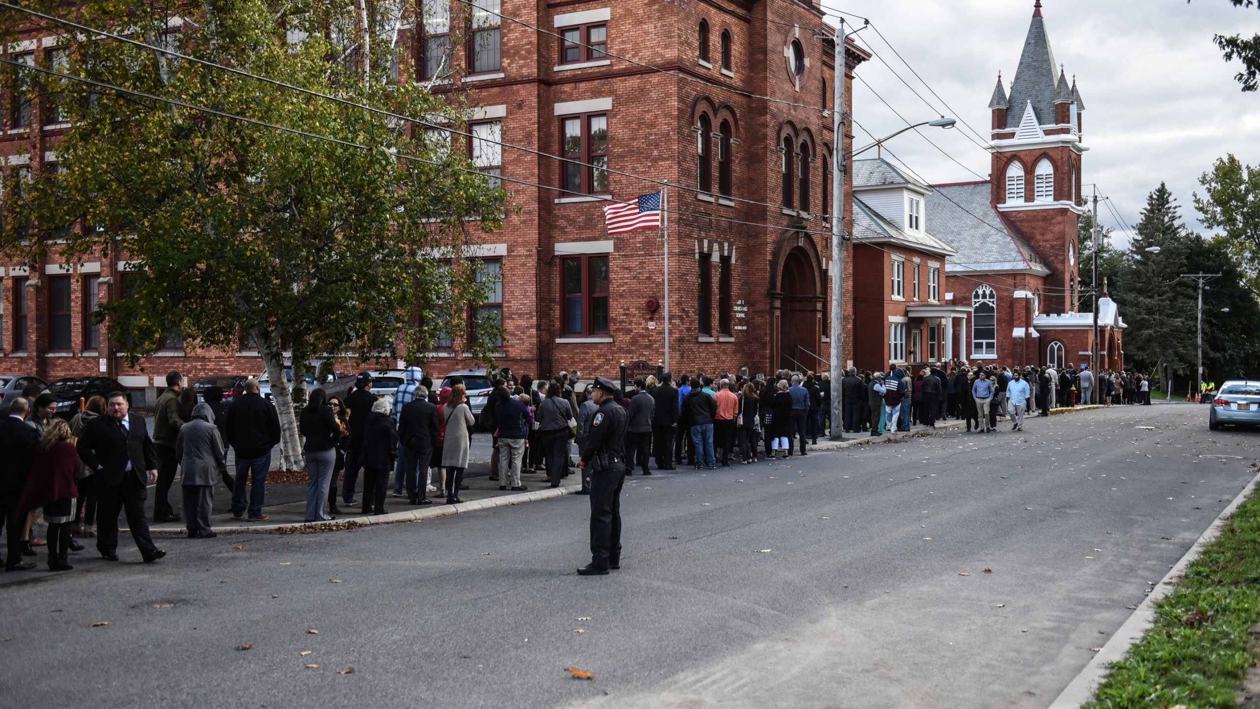 Mourners line up in front of St. Stanislaus Roman Catholic Church to pay their respects to some of the victims in last weekend's fatal limo crash on October 12, 2018 in Amsterdam, New York. (Credit: Stephanie Keith/Getty Images)