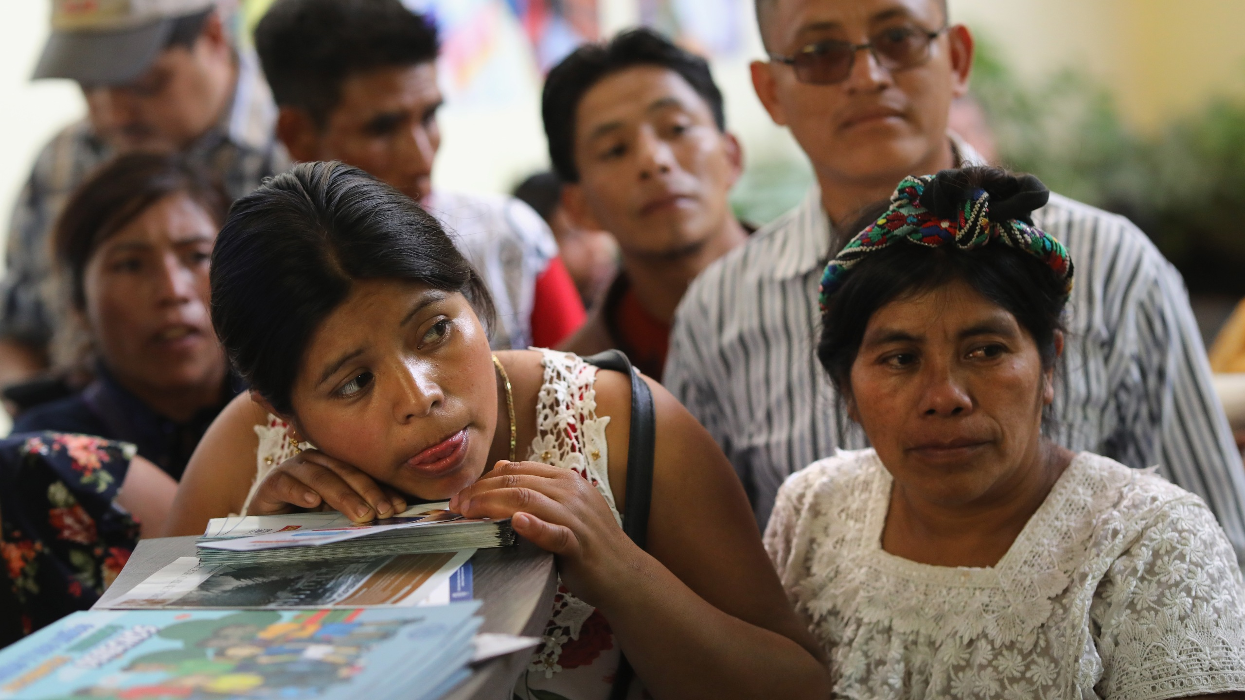 Families wait to embrace their children for the first time in months after being separated by U.S. border agents, Aug. 7, 2018, in Guatemala City, Guatemala. (Credit: John Moore / Getty Images)