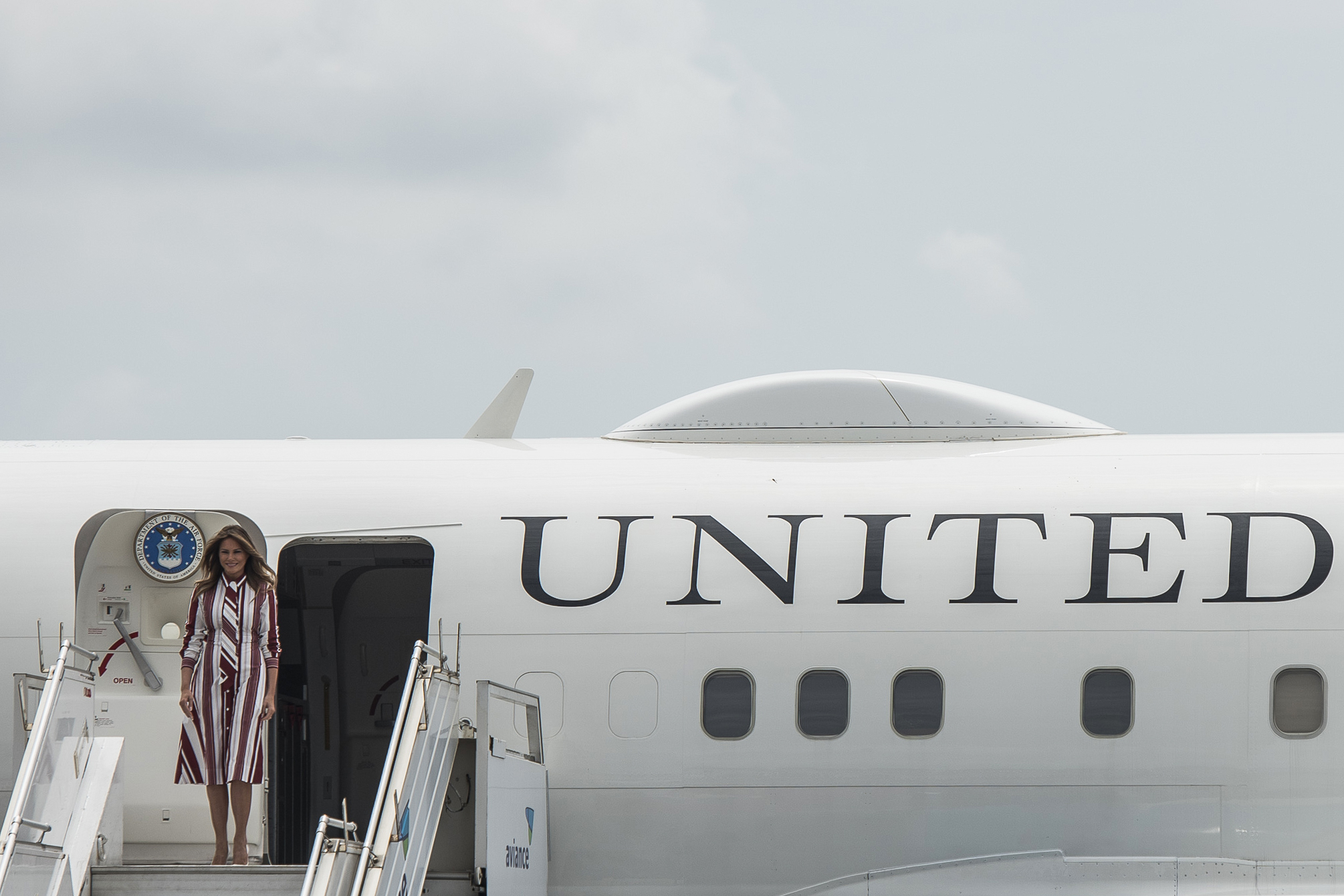 US First Lady Melania Trump disembarks from her plane after landing at Kotoka International Airport in Accra October 2, 2018. (Credit: CRISTINA ALDEHUELA/AFP/Getty Images)