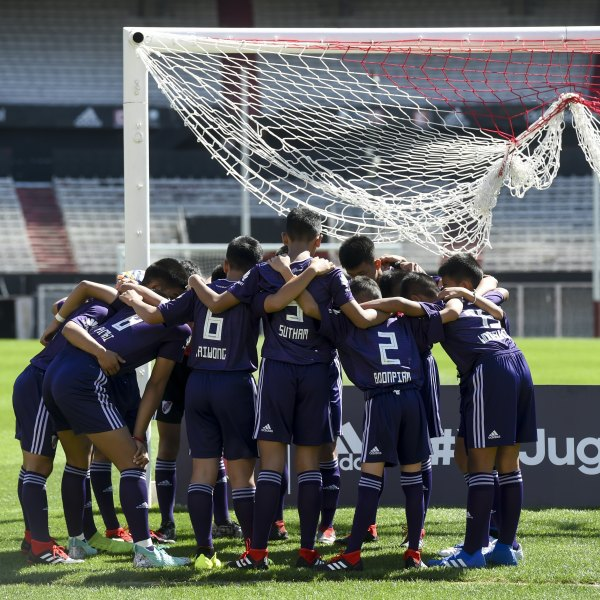 Young footballers of Thai team Wild Boars -who were rescued from the Tham Luang cave in Thailand get ready for a football match against River Plate Youth Team at Monumental stadium, in Buenos Aires on Oct. 7, 2018. (Credit: Eitan Abramovic/POOL /AFP/Getty Images)