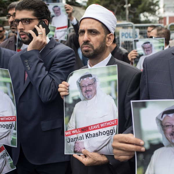 People hold posters of missing Saudi journalist Jamal Khashoggi during a protest organized by members of the Turkish-Arabic Media Association at the entrance to Saudi Arabia's consulate on Oct. 8, 2018 in Istanbul. (Credit: Chris McGrath/Getty Images)