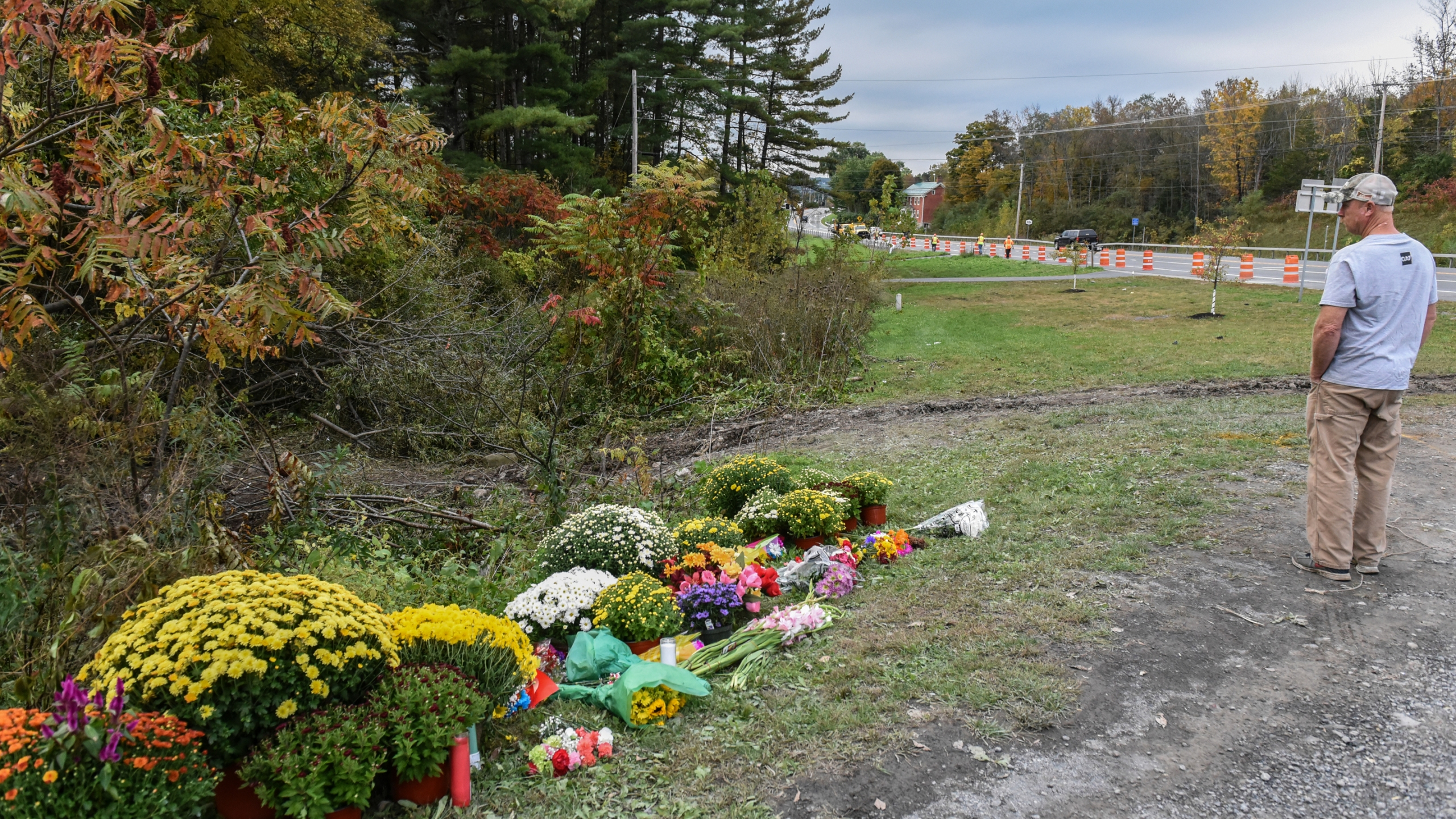 A mourner looks on at the site of the fatal limousine crash on October 8, 2018 in Schoharie, New York. 20 people died in the crash including the driver of the limo, 17 passengers, and two pedestrians. (Credit: Stephanie Keith/Getty Images)