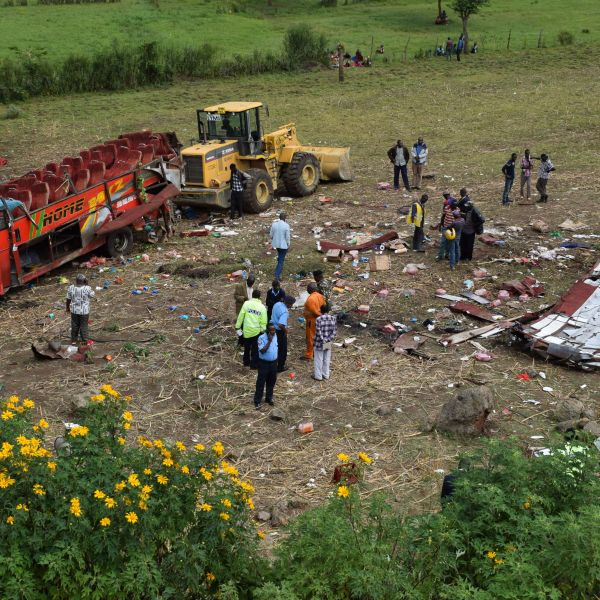 Kenyan emergency personnel and security forces inspect the wreckage of a bus at the site of an accident in Kericho, western Kenya, on October 10, 2018. (Credit: Brian Ongoro/AFP/Getty Images)