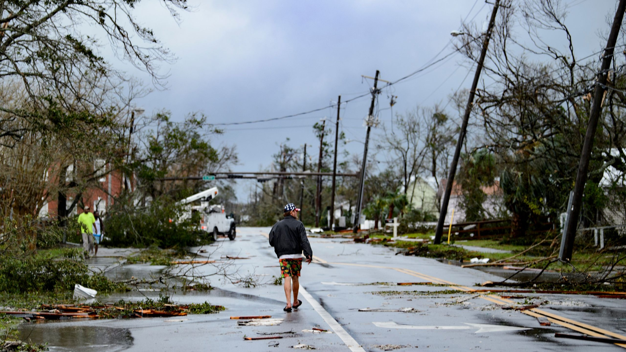 A man walks down the street after Hurricane Michael made landfall on October 10, 2018 in Panama City, Florida. (Credit: BRENDAN SMIALOWSKI/AFP/Getty Images)