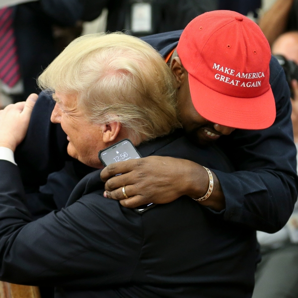 Donald Trump hugs rapper Kanye West during a meeting in the Oval office on Oct. 11, 2018. (Credit: Oliver Contreras - Pool/Getty Images)