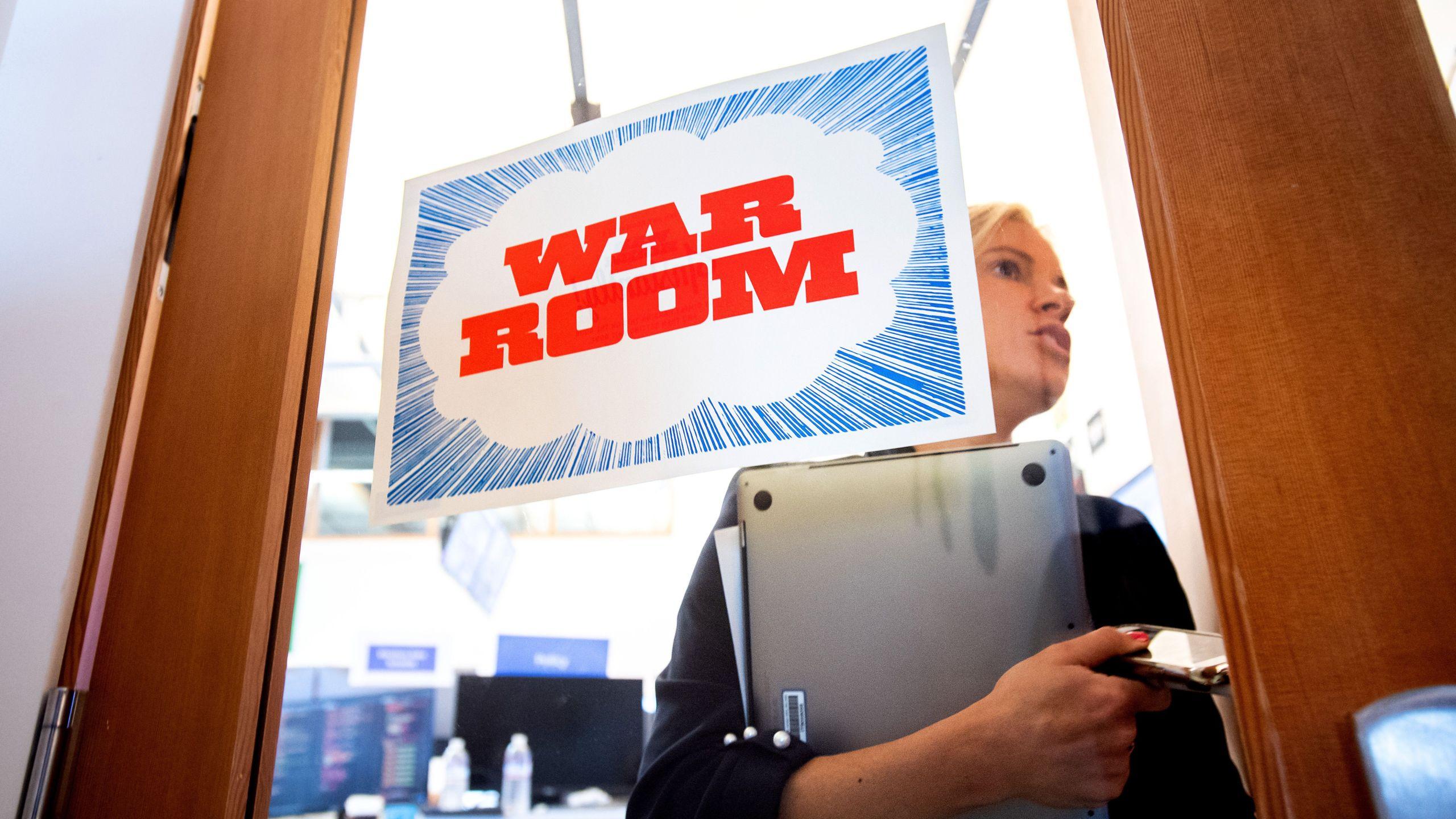 "Facebook worker Erin Landers leaves the company's ""War Room"" during a media demonstration on Oct. 17, 2018 in Menlo Park. (Credit: NOAH BERGER/AFP/Getty Images)"