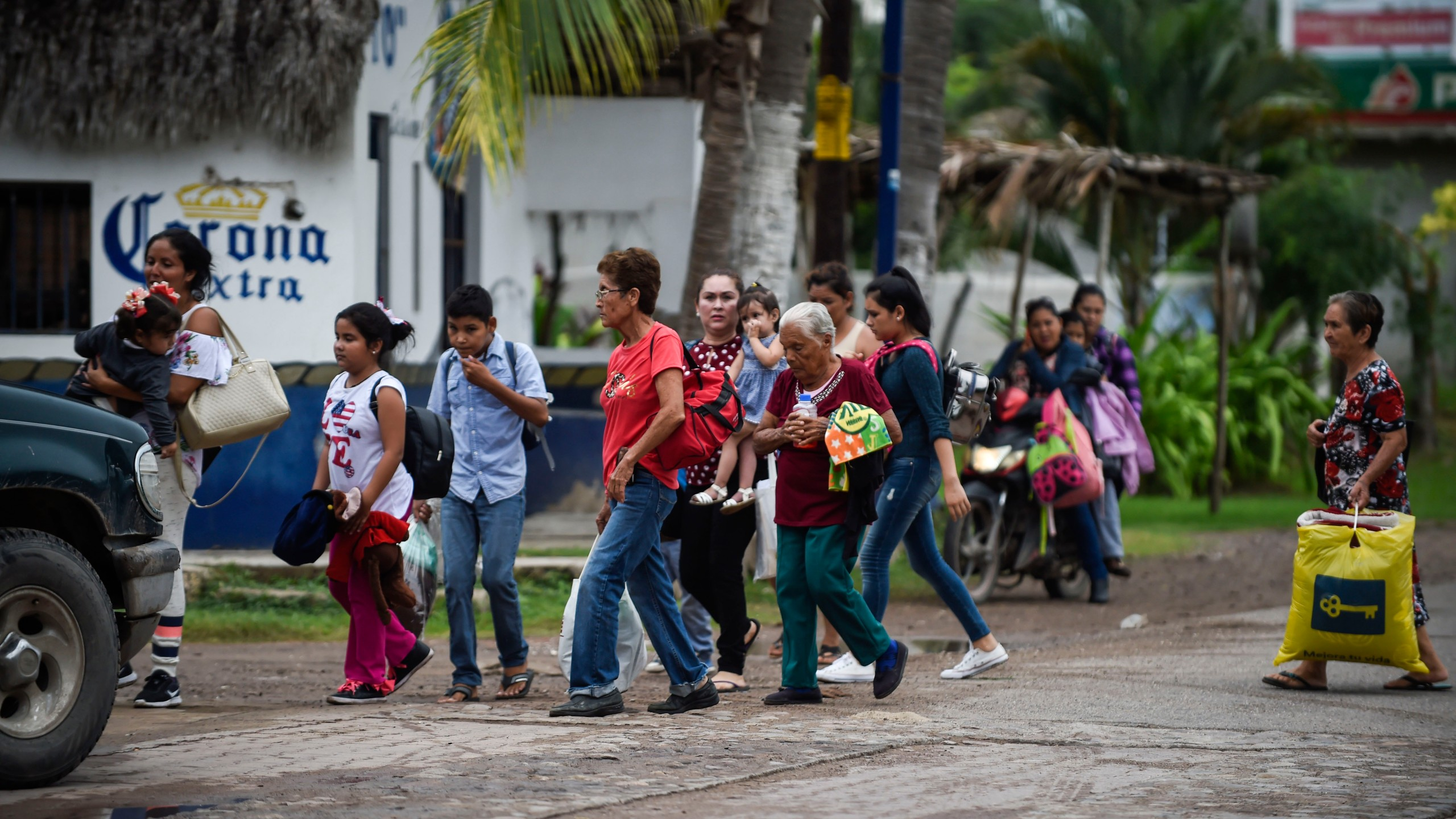 People prepare to be evacuated in Teacapan, Sinaloa state, Mexico, on Oct. 22, 2018, before the arrival of Hurricane Willa. (Credit: Alfredo Estrella / AFP / Getty Images)