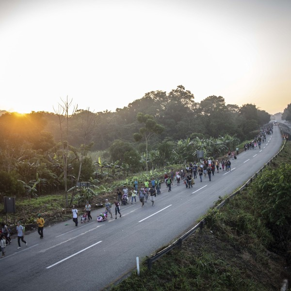 Migrants heading in a caravan to the U.S., walk alongside the road in Huixtla on their way to Mapastepec Chiapas state, Mexico, on October 24, 2018. (Credit: PEDRO PARDO/AFP/Getty Images)