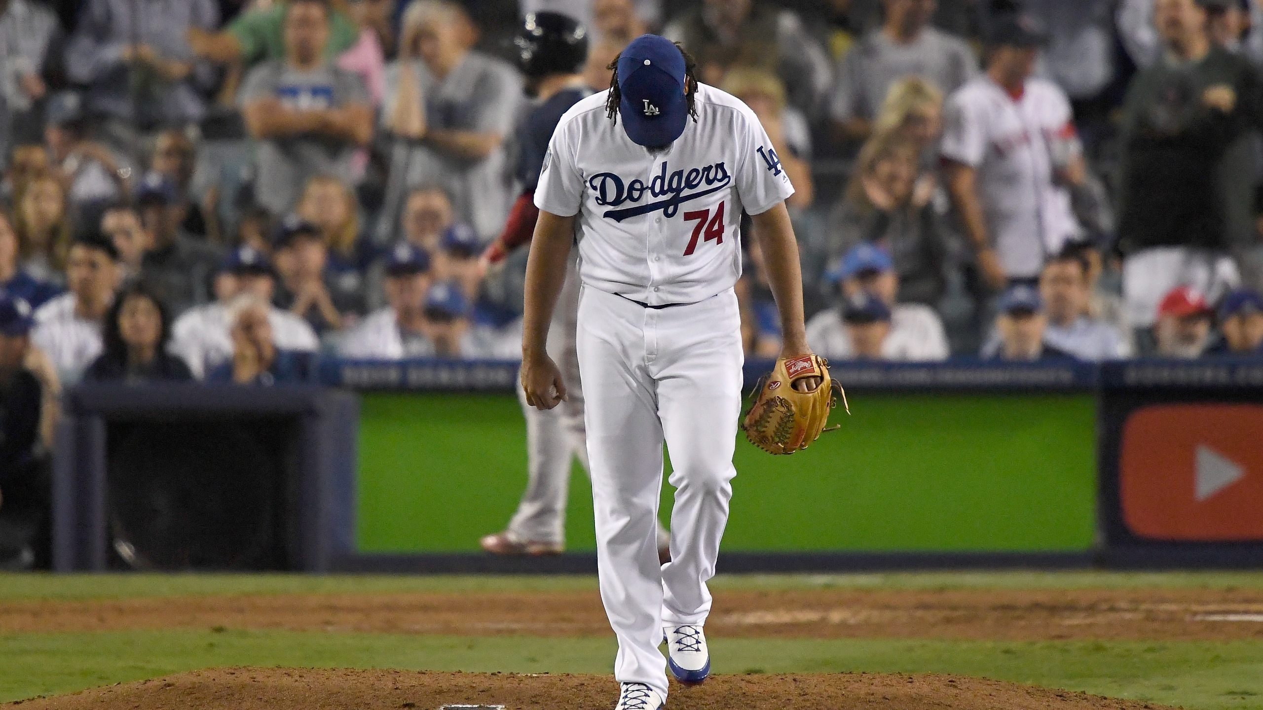 Pitcher Kenley Jansen #74 of the Los Angeles Dodgers looks down at the mound after giving up a solo home run to tie the game at 4-4 to Steve Pearce #25 of the Boston Red Sox in the eighth inning of Game 4 of the 2018 World Series at Dodger Stadium on Oct. 27, 2018, in Los Angeles. (Credit: Kevork Djansezian/Getty Images)