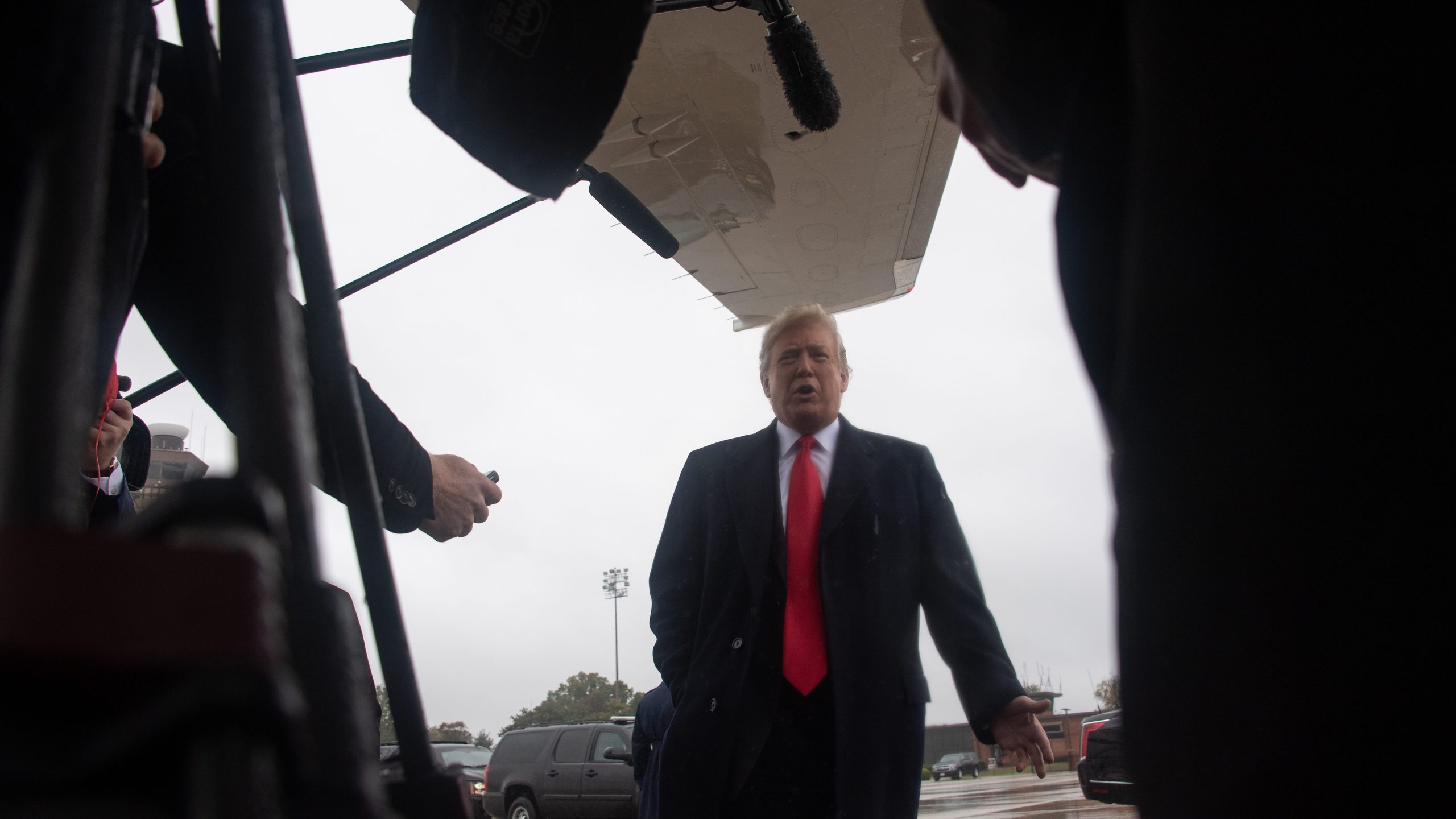 Donald Trump speaks to the press before boarding Air Force One at Andrews Air Force Base in Maryland on Oct. 27, 2018. (Credit: NICHOLAS KAMM/AFP/Getty Images)