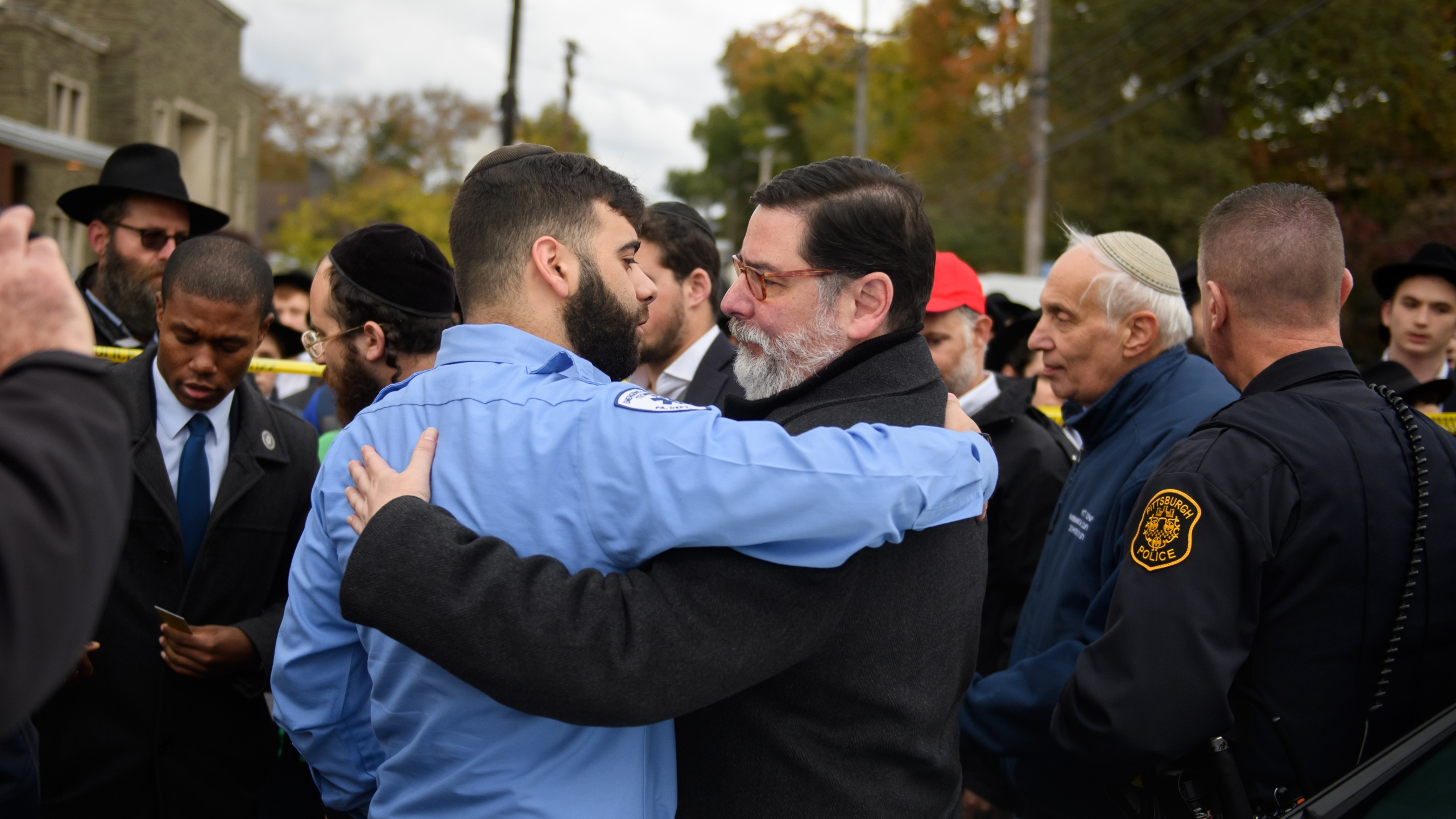 Pittsburgh Mayor Bill Peduto hugs an EMT after a prayer held at the site of the mass shooting that killed 11 people on Oct. 29, 2018. (Credit: Jeff Swensen/Getty Images)