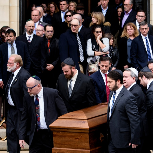 Pallbearers carry a casket from Rodef Shalom Congregation following the funeral for Tree of Life Congregation mass shooting victims, brothers Cecil Rosenthal and David Rosenthal, Oct. 30, 2018, in Pittsburgh, Pennsylvania. (Credit: Brendan Smialowski / AFP) (Photo credit should read BRENDAN SMIALOWSKI/AFP/Getty Images)