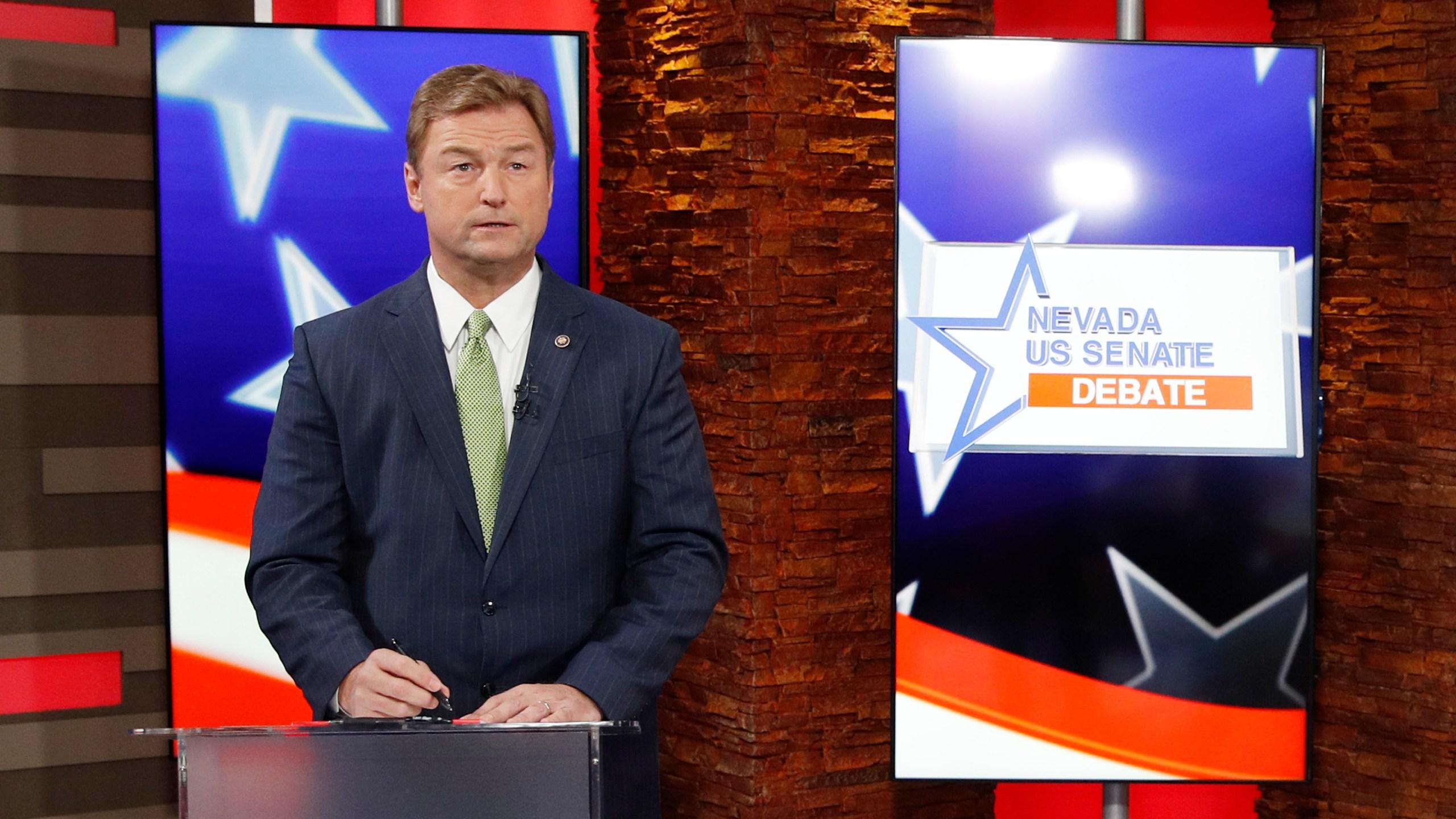 U.S. Sen. Dean Heller, R-NV, prepares for his debate with U.S. Rep. Jacky Rosen, D-NV, at KLAS Channel 8 Studios on Oct. 19, 2018 in Las Vegas. (Credit: John Locher-Pool/Getty Images)