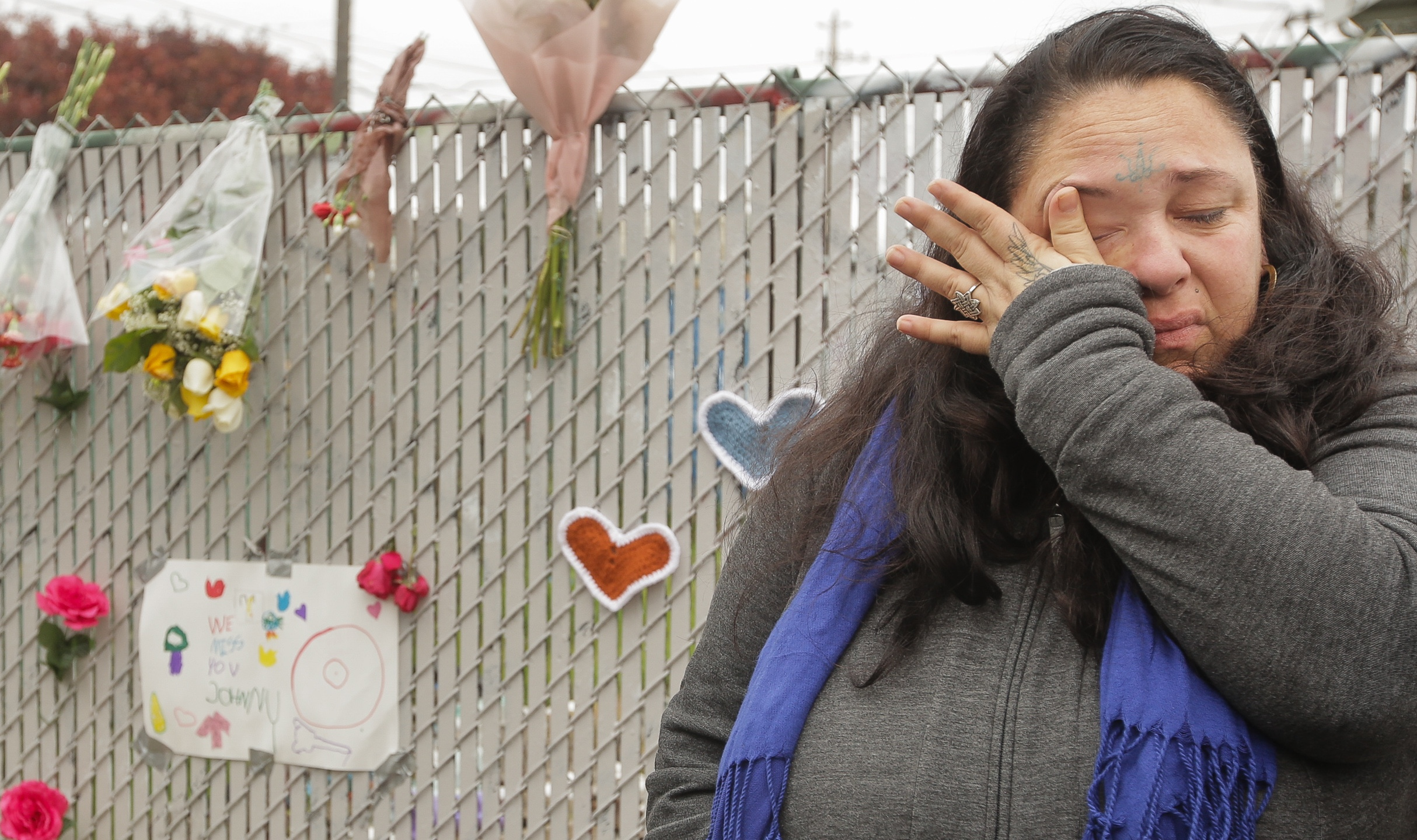 Danielle Boudreaux, who knew the man who rented out the Ghost Ship warehouse for parties and was a frequent visitor herself, cries by a makeshift memorial near the site of a warehouse fire that has claimed the lives of at least 36 people on Dec. 5, 2016, in Oakland. (Credit: Elijah Nouvelage/Getty Images)