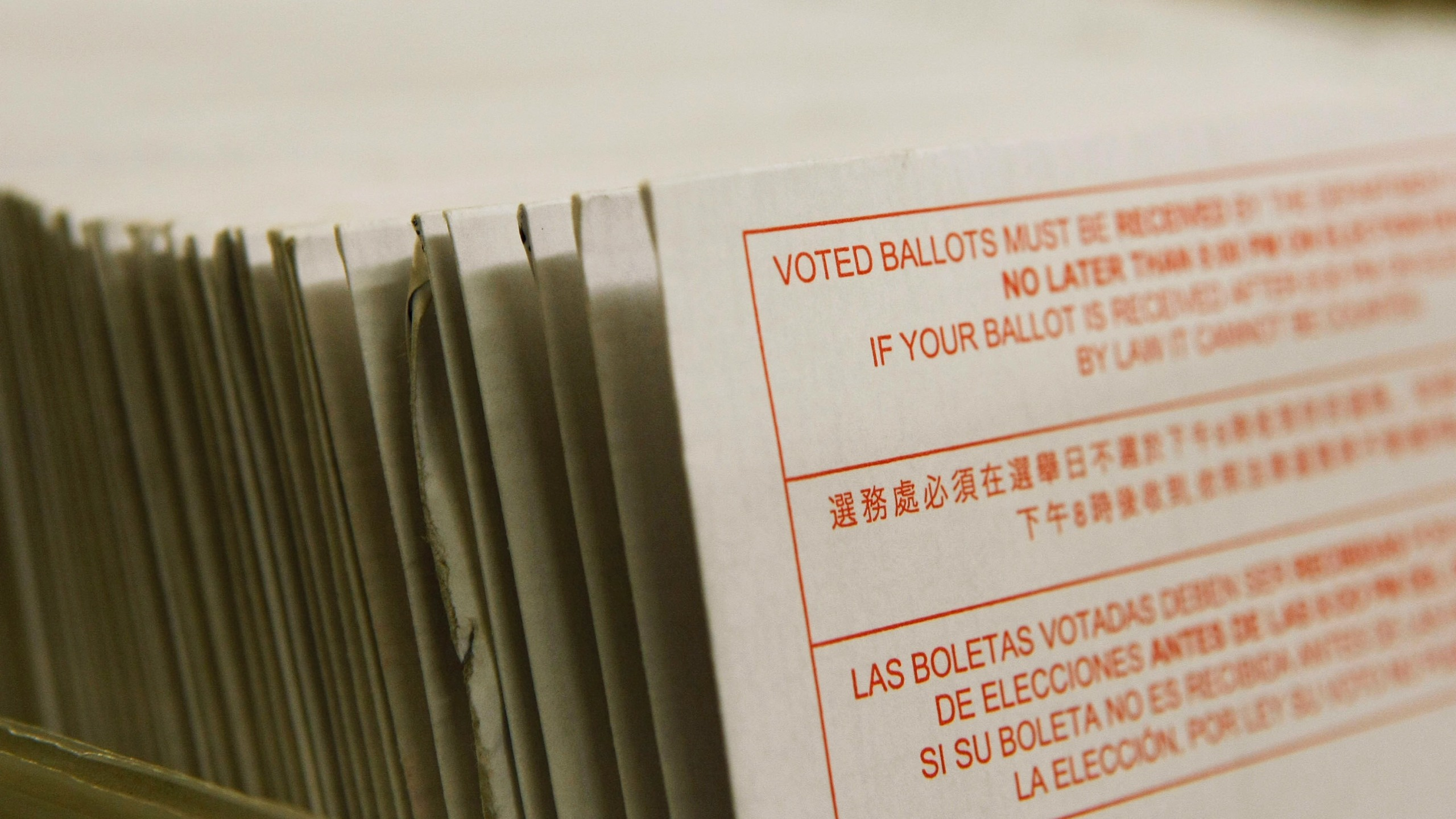 A stack of vote-by-mail ballots sit in a box after being sorted at the San Francisco Department of Elections January 24, 2008 in San Francisco. (Credit: Justin Sullivan/Getty Images)