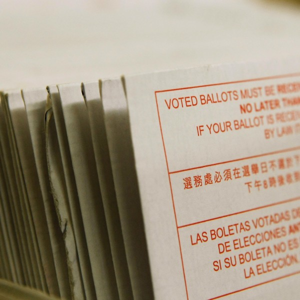 A stack of vote-by-mail ballots sit in a box after being sorted at the San Francisco Department of Elections January 24, 2008 in San Francisco. (Justin Sullivan/Getty Images)