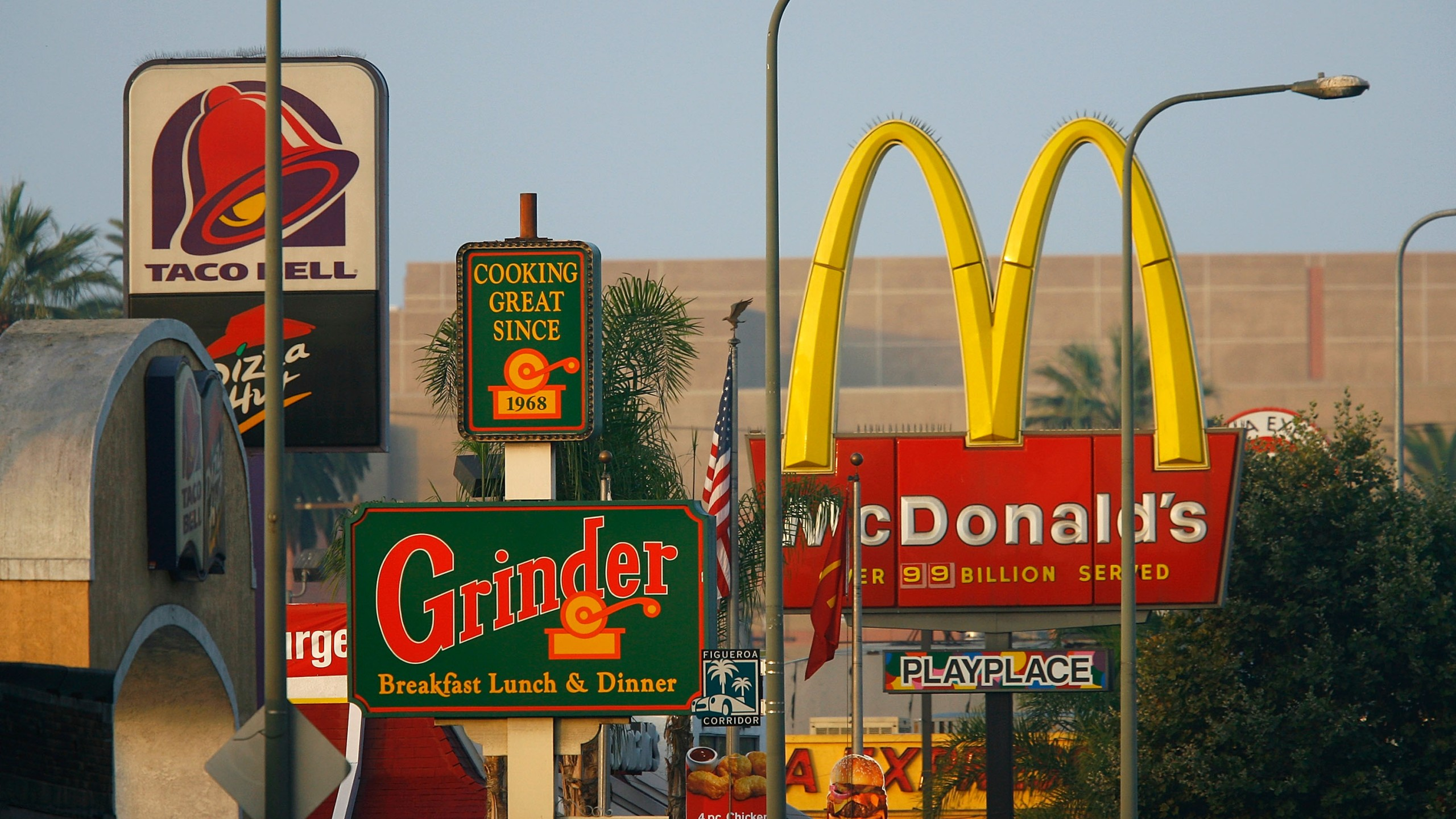 Signs for Taco Bell, Grinder, McDonald's and Panda Express fast-food restaurants line the streets in the Figueroa Corridor area of South Los Angeles on July 24, 2008. (Credit: David McNew / Getty Images)