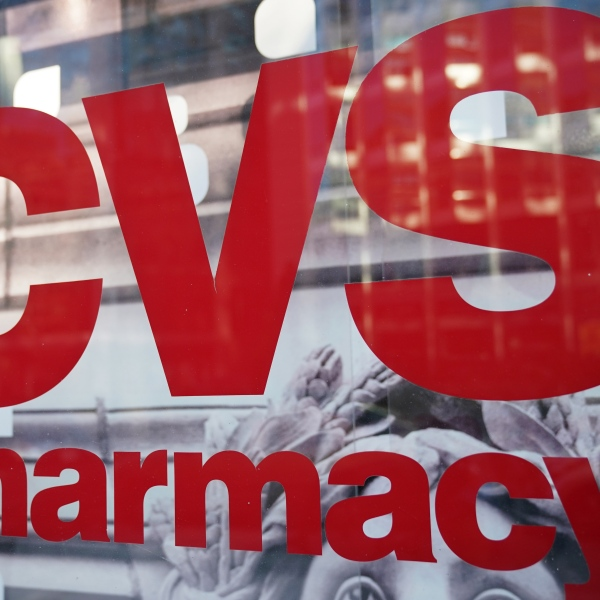 The CVS logo is seen in front of one of its stores in Washington, D.C on Dec. 3, 2017. (Credit: MANDEL NGAN/AFP/Getty Images)