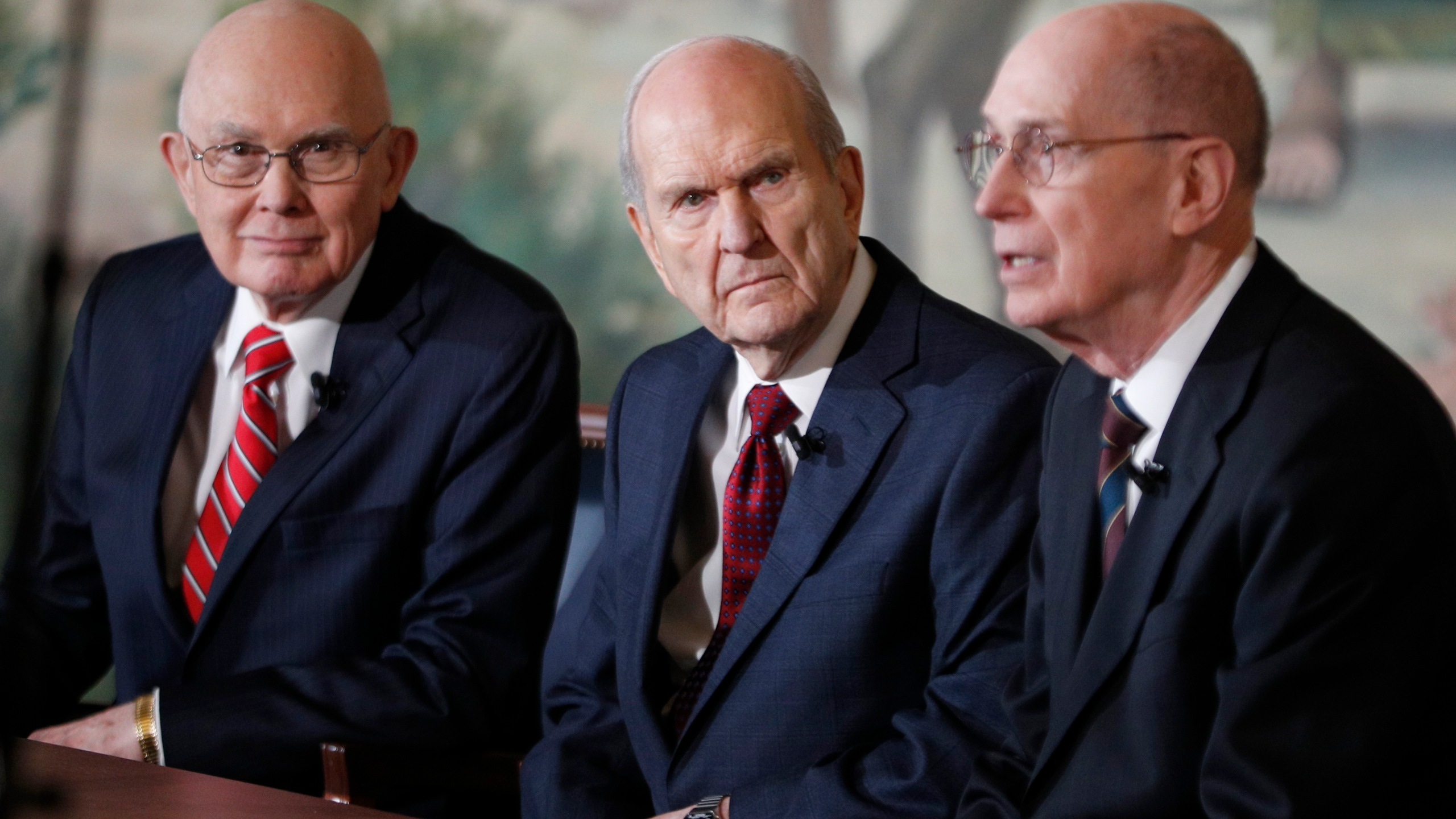 Russell M. Nelson, center, Dallin H. Oaks, left, and Henry B. Eyring, right, answer question from the press after Nelson was announced as the 17th president of the Mormon Church on Jan.16, 2017 in Salt Lake City, Utah. (Credit: George Frey/Getty Images)