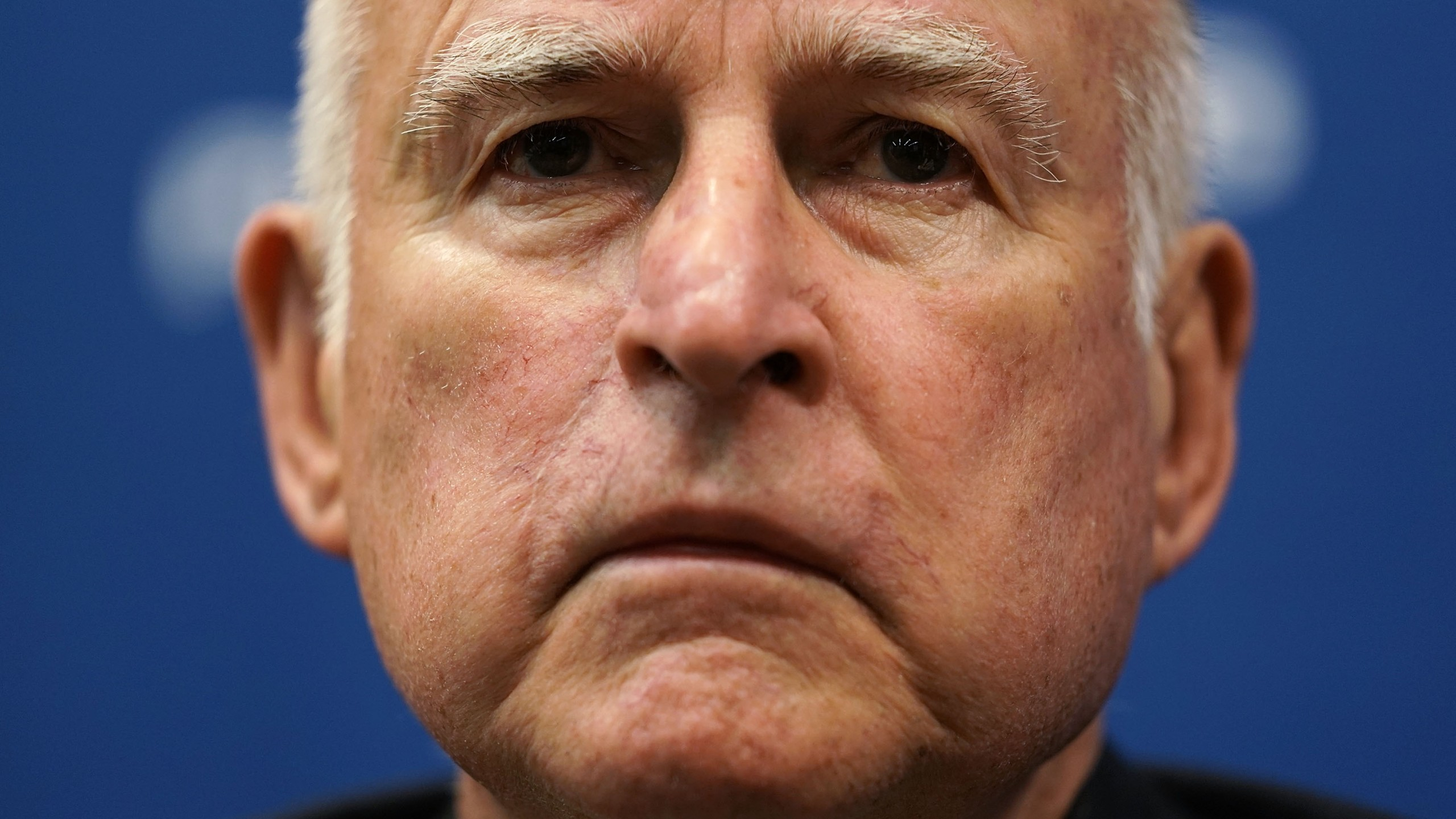 Gov. Jerry Brown listens during an event at the National Press Club April 17, 2018 in Washington, DC. (Credit: Alex Wong/Getty Images)