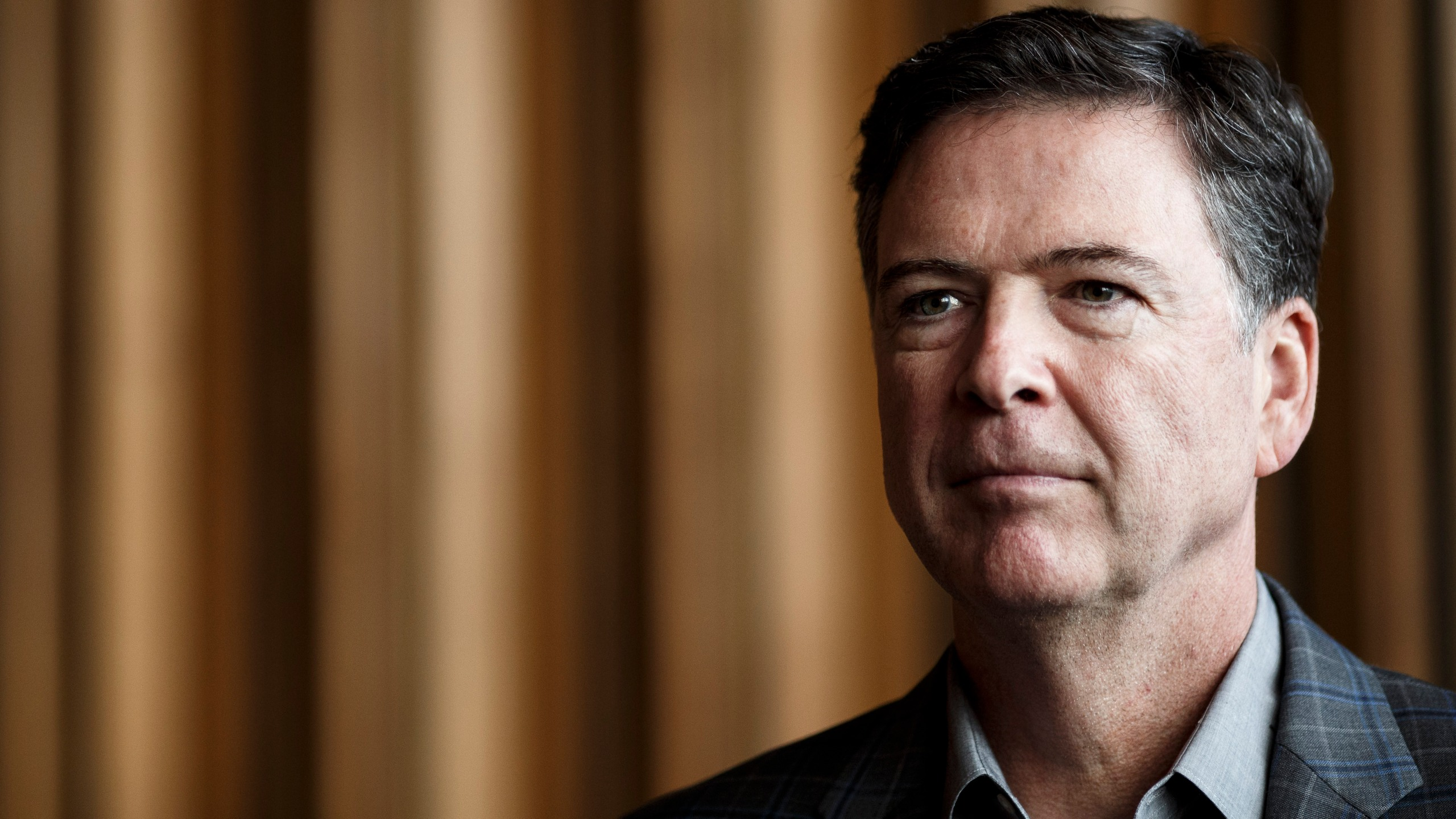 Former FBI Director James Comey talks backstage before a panel discussion about his book on June 19, 2018 in Berlin, Germany. (Credit: Carsten Koall/Getty Images)