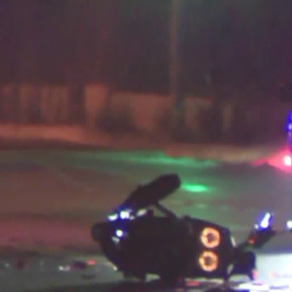 Authorities investigate the scene of a deadly motorcycle crash in Huntington Park on Oct. 21, 2018. (Credit: KTLA)