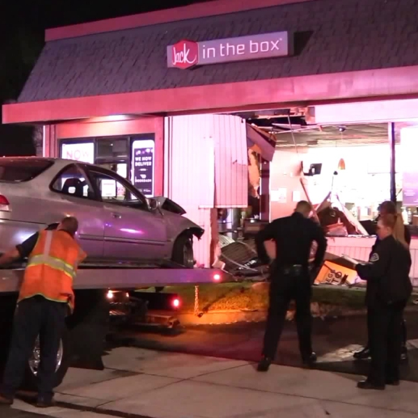 A car is removed from a Jack in the Box in Huntington Beach after crashing on Oct. 12, 2018. (Credit: OC Hawk)
