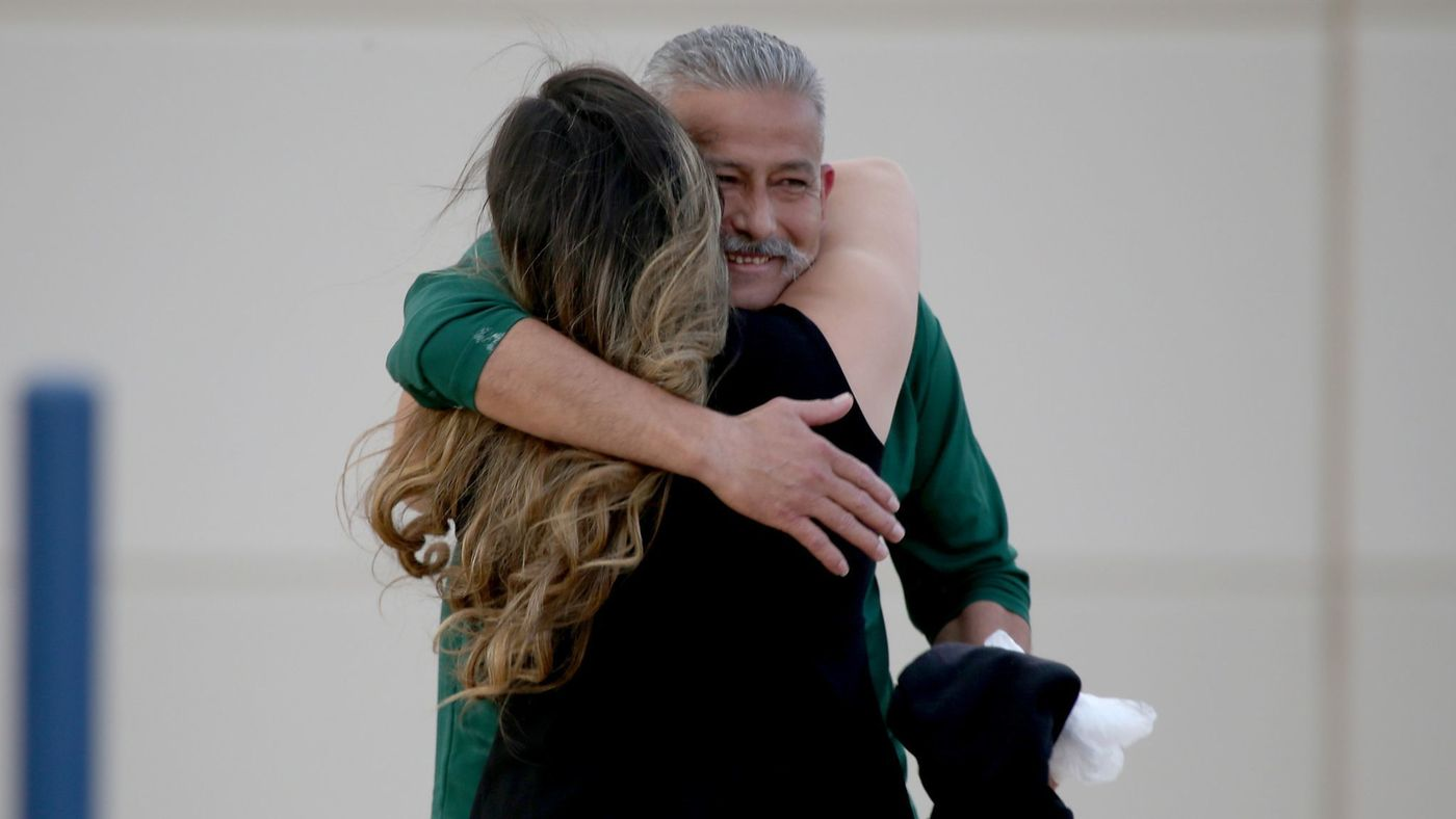 Romulo Avelica Gonzalez, 49, spent six months at an immigration detention facility in Adelanto investigated by federal officials for harsh, sometimes dangerous conditions. Here, he is seen embracing his daughter in 2017 after being released. (Credit: Luis Sinco / Los Angeles Times)