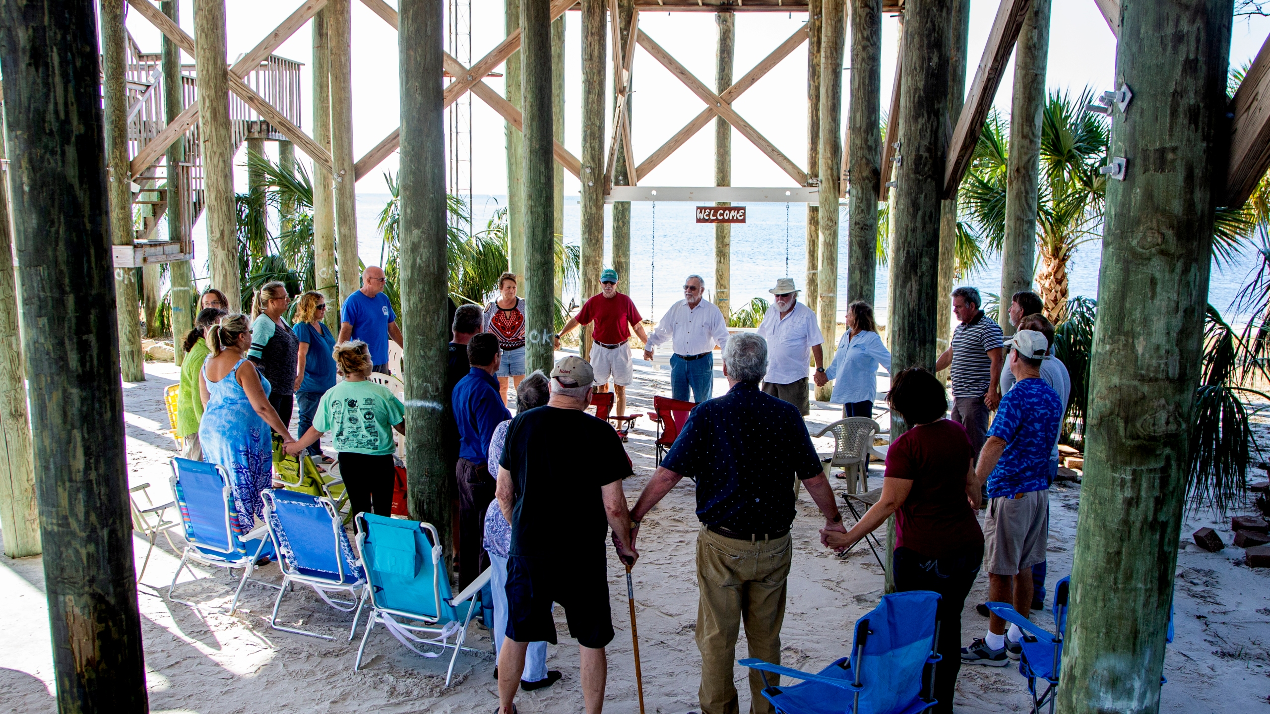 Pastor Gary Pritchett leads the prayer during church service under the Seafarers Chapel at Shell Point on October 14, 2018 in Crawfordville, Florida. According to reports, at least 17 people have died since Hurricane Michael made landfall along the Florida Panhandle Wednesday as a Category 4 storm. (Credit: Mark Wallheiser/Getty Images)