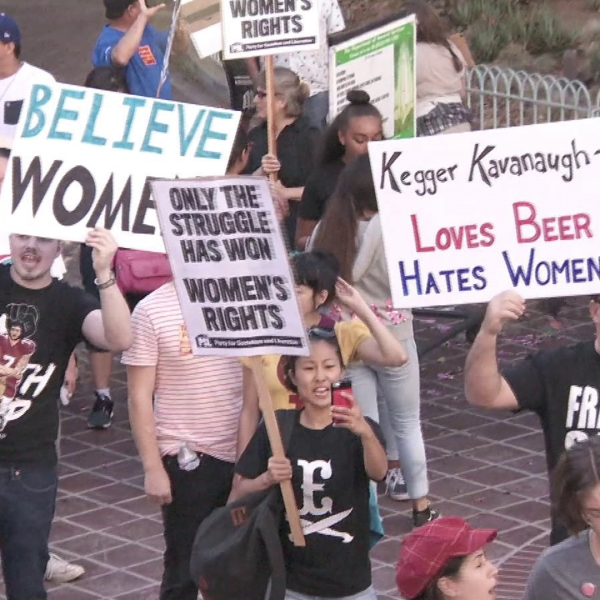 Protesters rally against the confirmation of Brett Kavanaugh, who's accused of sexual assault, to the Supreme Court during a rally in downtown L.A. on Oct. 7, 2018. (Credit: KTLA)