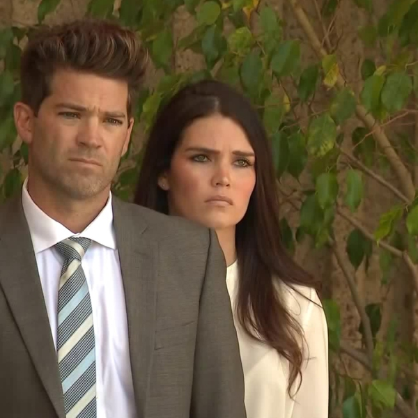 Grant Robicheaux and Cerissa Riley look on as their attorneys speak outside a Newport Beach courthouse on Oct. 17, 2018. (Credit: KTLA)