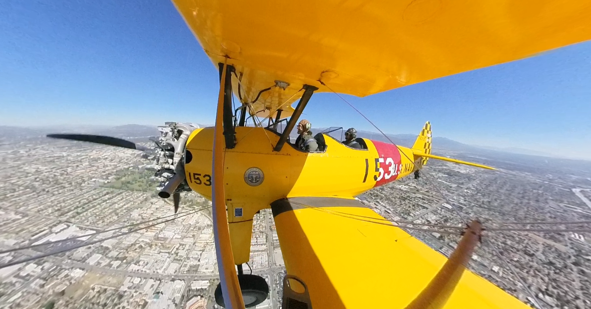 San Gabriel Valley Airport Association President Gabe Lopez pilots his 1939 Stearman biplane over the San Gabriel Valley, with KTLA Digital Producer Giovanni Moujaes riding along, on Oct. 16, 2018.