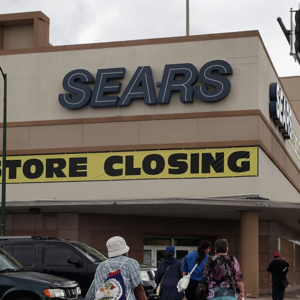 A sign announcing the store will be closing hangs above a Sears store on August 24, 2017 in Chicago, Illinois. (Credit: Scott Olson/Getty Images)