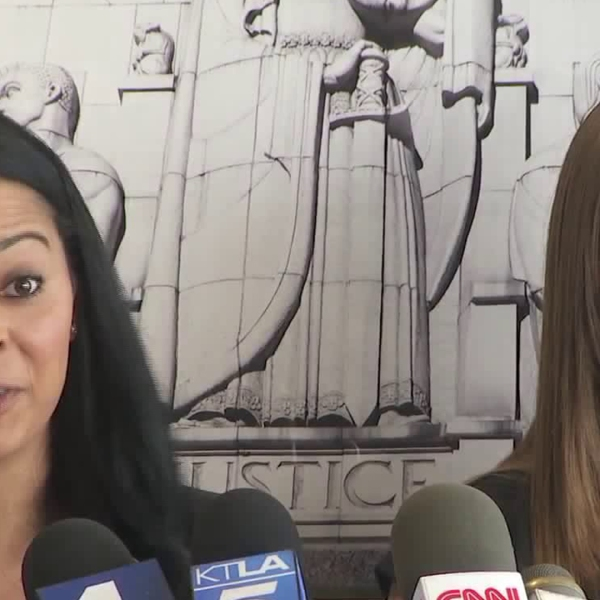 Tasha Schwikert, 33, a former Olympic gymnast, and her sister, Jordan Schwikert, 32, a former elite college gymnast and current coach, speak about their lawsuits against USA Gymnastics and the U.S. Olympic Committee over sexual abuse by doctor Larry Nassar, during a news conference in Los Angeles on Oct. 29, 2018. (Credit: KTLA)