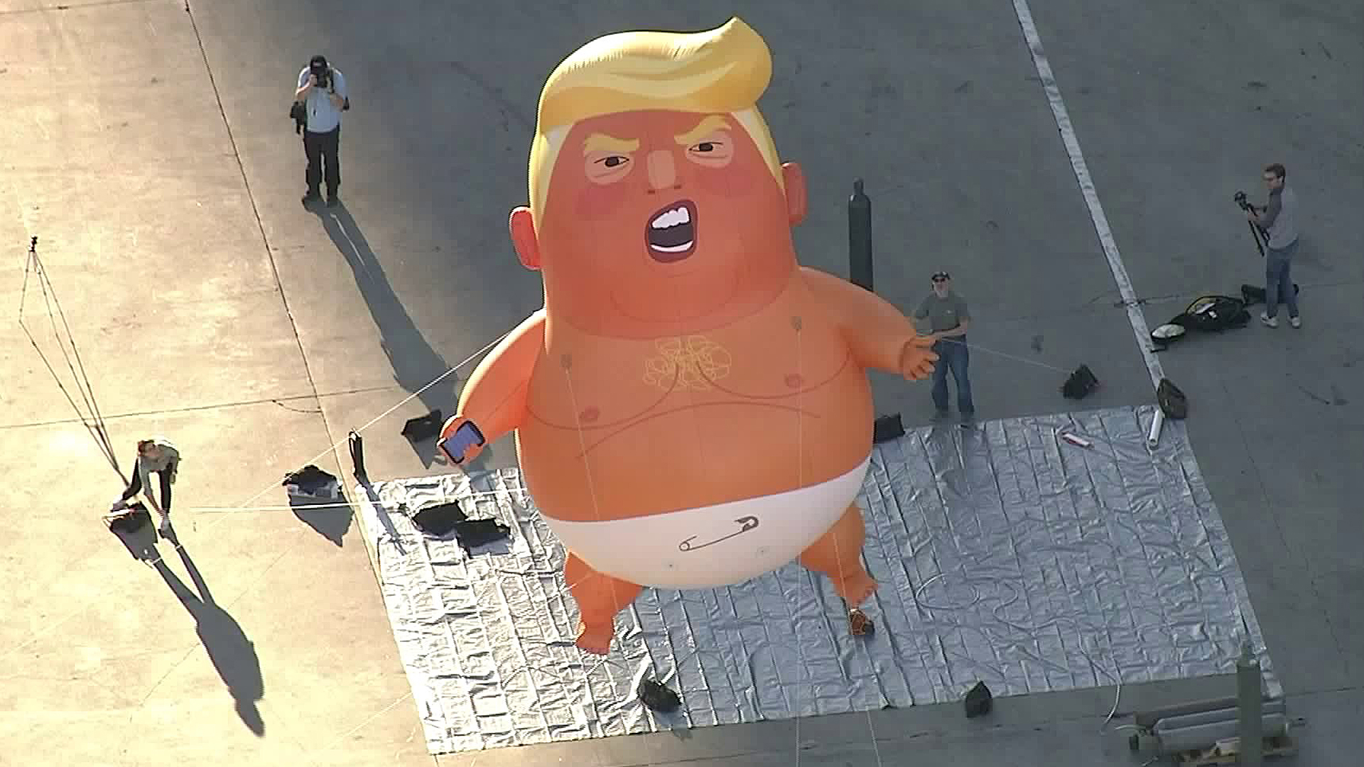A giant balloon depicting U.S. President Donald Trump as an orange baby is seen in downtown Los Angeles on Oct. 19, 2018. (Credit: KTLA)