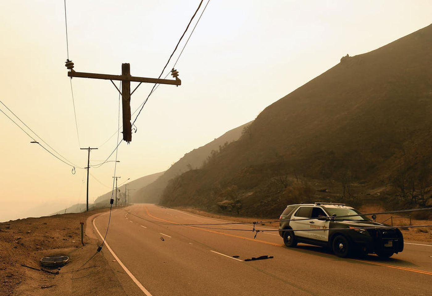 Only the top few feet of a utility pole survived the Woolsey Fire as it roared over Kanan Road in Malibu. (Credit: Wally Skalij/Los Angeles Times)