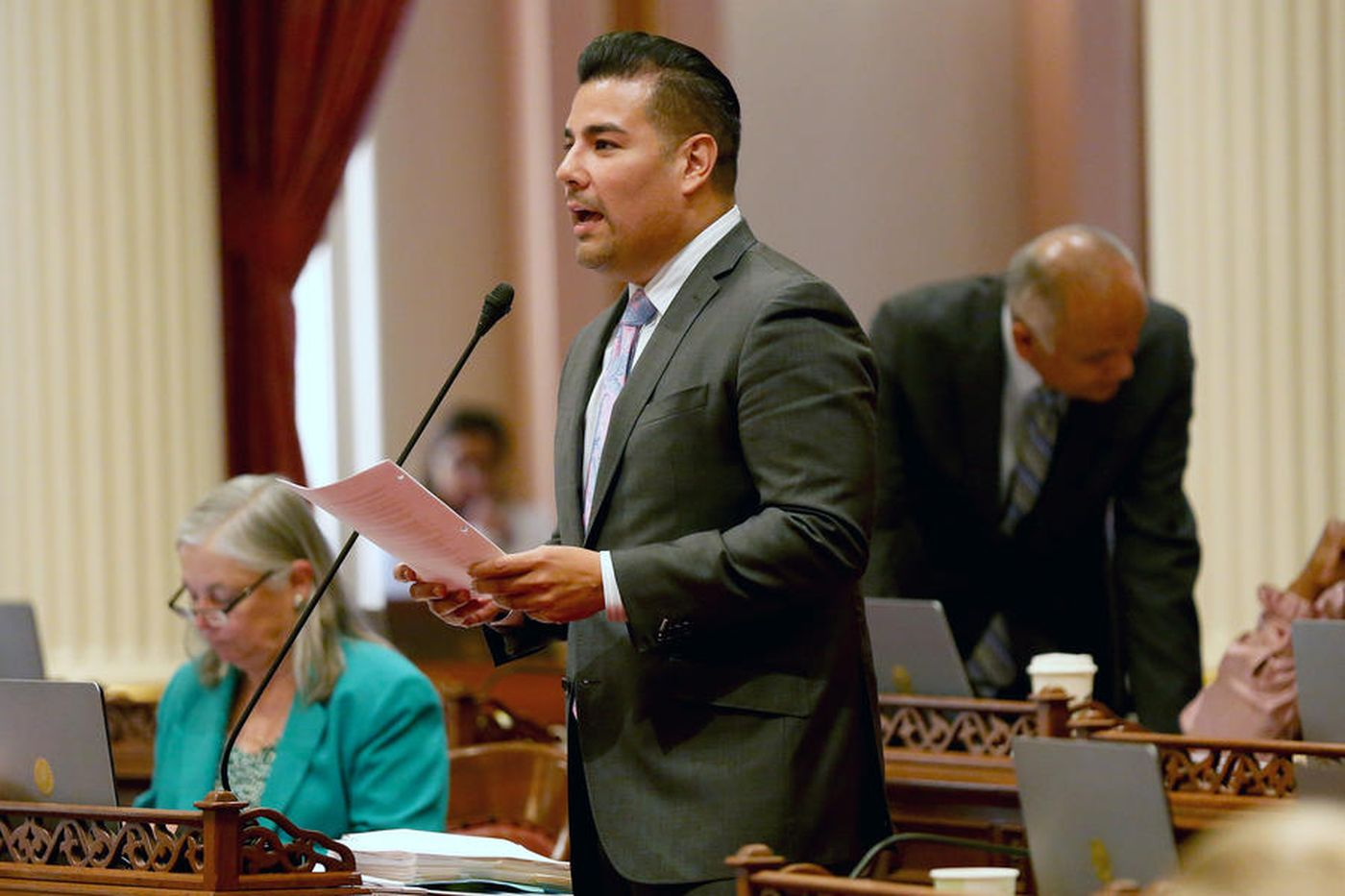 State Sen. Ricardo Lara presents a bill on the Senate floor in this undated photo. (Credit: Gary Coronado / Los Angeles Times)