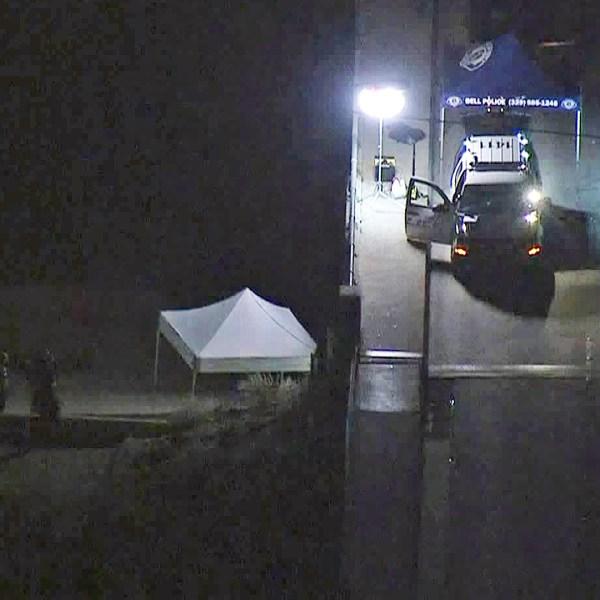 Investigators respond to a homicide scene in Bell on Nov. 19, 2018. (Credit: KTLA)