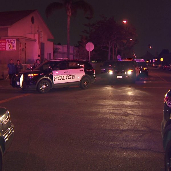 Authorities investigate the scene of an officer-involved shooting in the 5900 block of Loveland Street in Bell Gardens on Nov. 21, 2018.