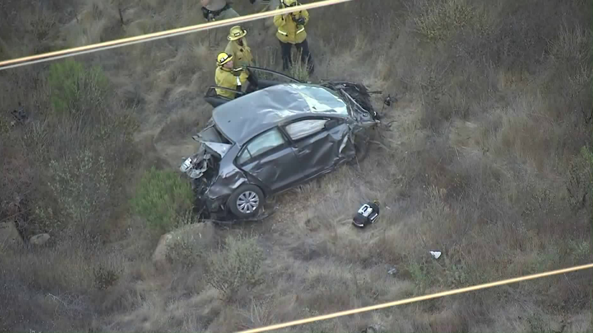 L.A. County Fire personnel responded to Castaic Canyons after a body was discovered in a car that went off the roadway on Nov. 7, 2018. (Credit: KTLA)