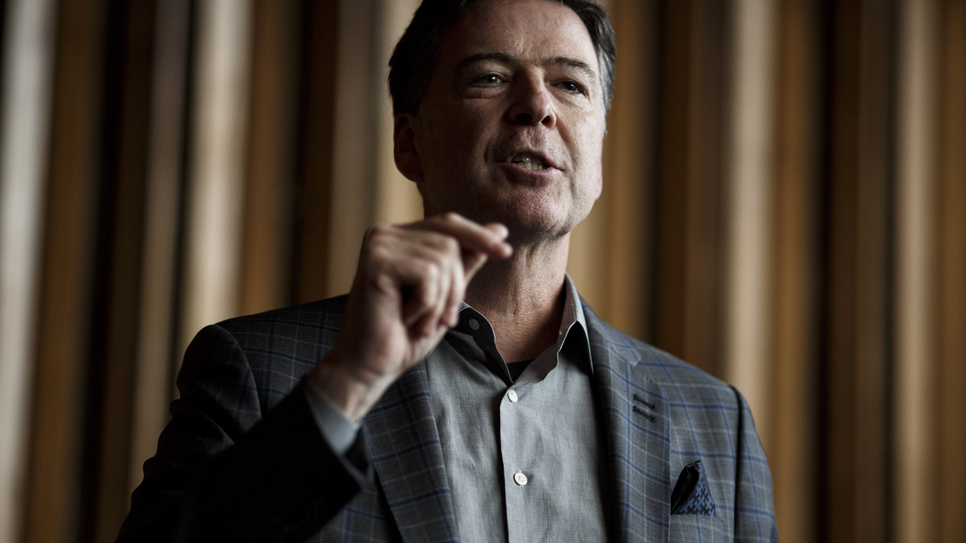 "Former FBI Director James Comey talks backstage before a panel discussion about his book ""A Higher Loyalty"" on June 19, 2018 in Berlin, Germany. (Credit: Carsten Koall/Getty Images)"
