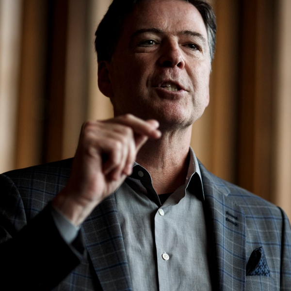 """Former FBI Director James Comey talks backstage before a panel discussion about his book """"A Higher Loyalty"""" on June 19, 2018 in Berlin, Germany. (Credit: Carsten Koall/Getty Images)"""